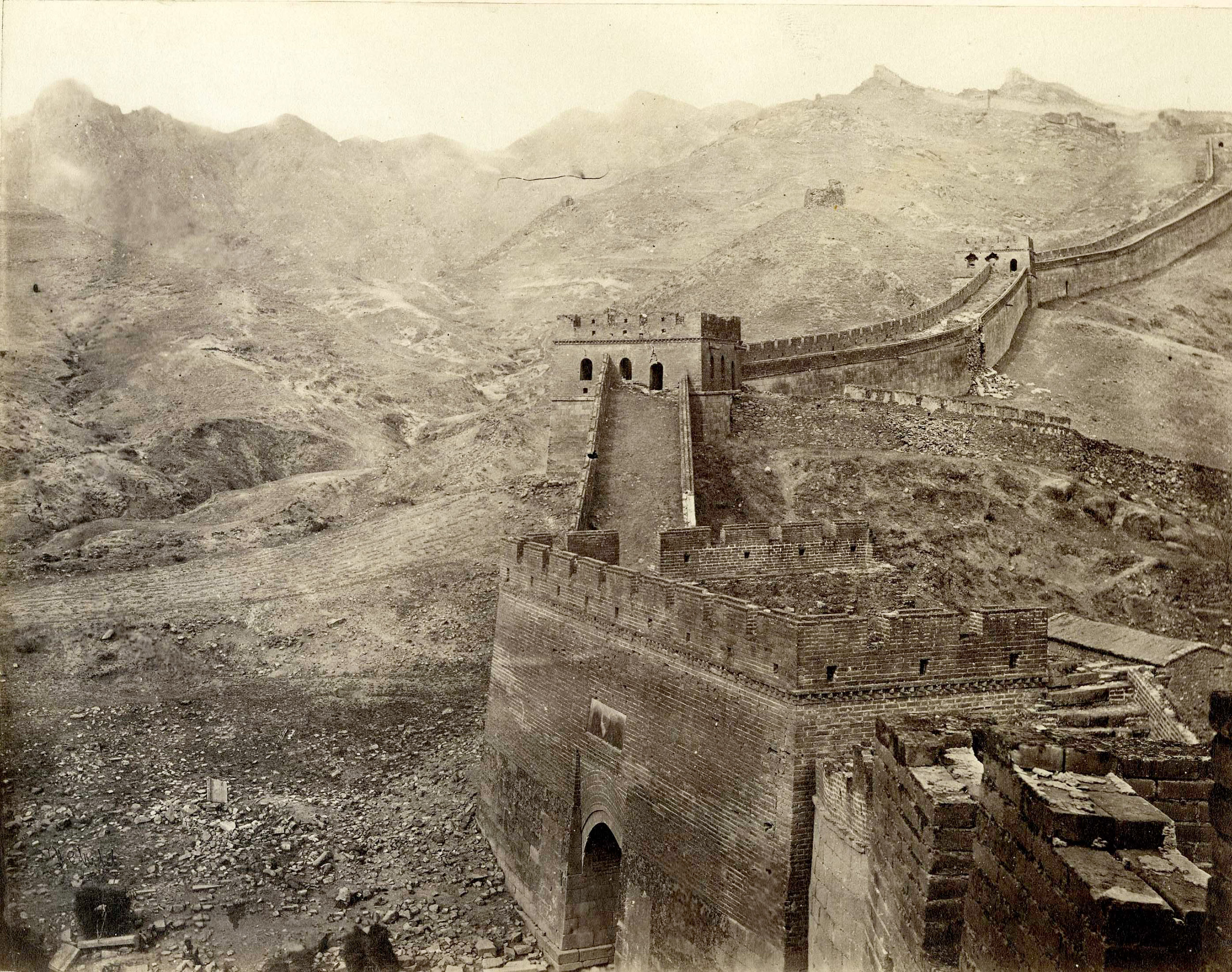 Caption from Stephan Lowentheil Collection. Photograph shows the section of the Great Wall that includes the Nan-K'ou pass leading to Mongolia. The pass was one of the main arteries through which trade flowed between China and Mongolia. The photograph provides evidence of the Qing practice of forest removal for security as well as building materials. The Chinese government reversed that policy in modern times, and trees now surround this portion of the wall.