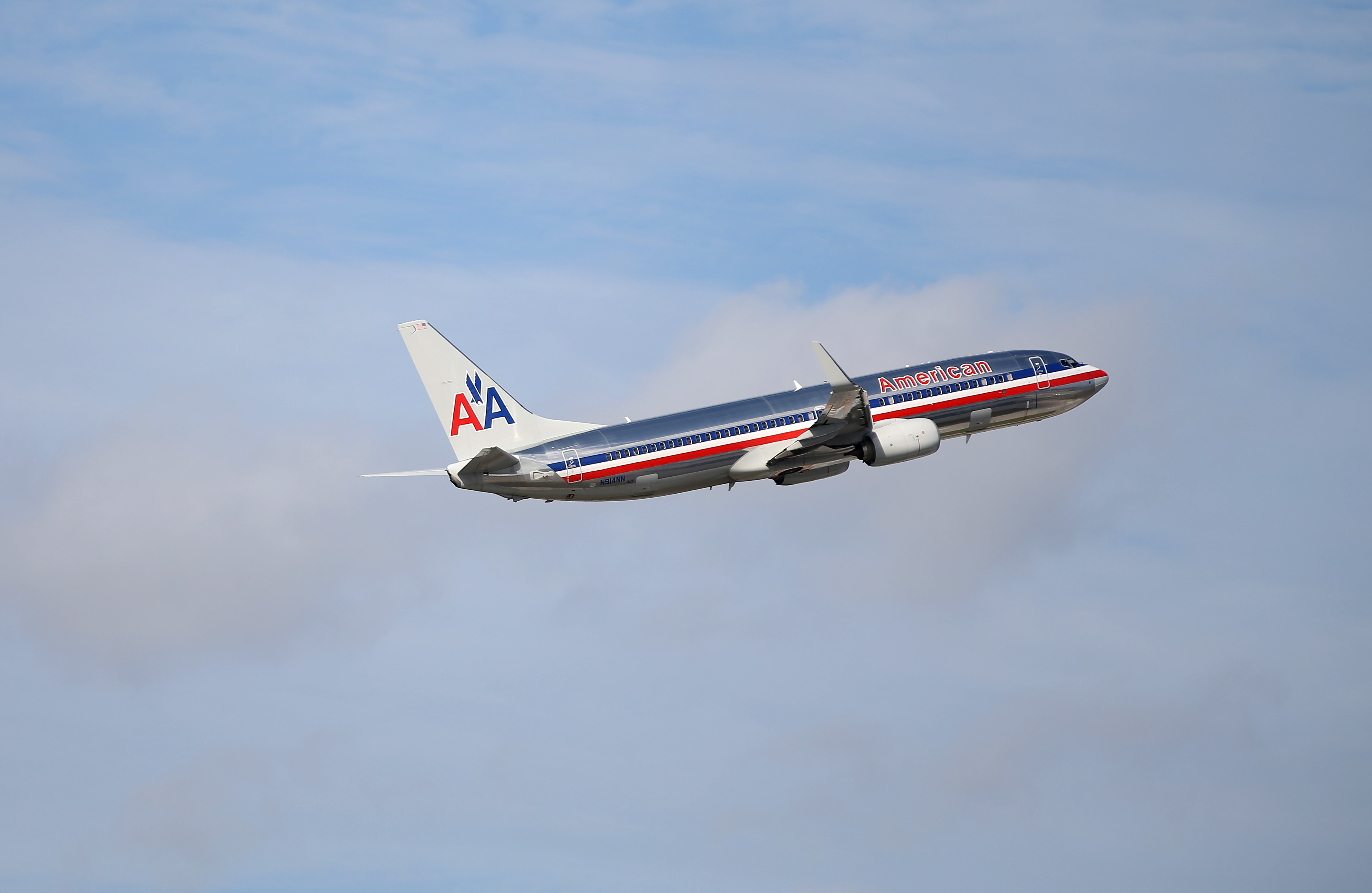 An American Airlines plane takes off from the Miami International Airport on Nov. 12, 2013 in Miami, Florida.
