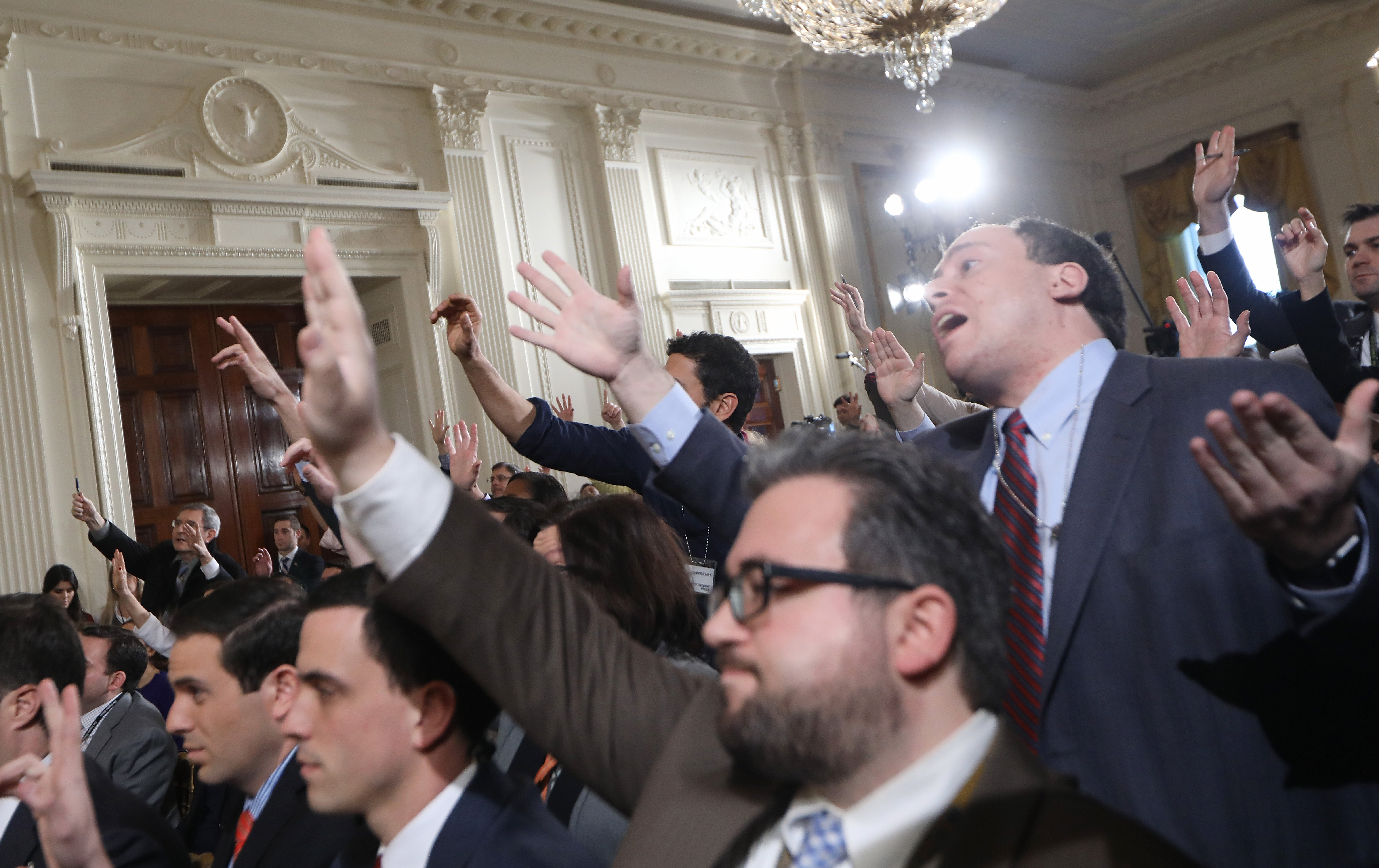 Reporters attempt to pose questions to President Donald Trump during a news conference announcing Alexander Acosta as the new Labor Secretary nominee in the East Room at the White House in Washington, on Feb. 16, 2017.