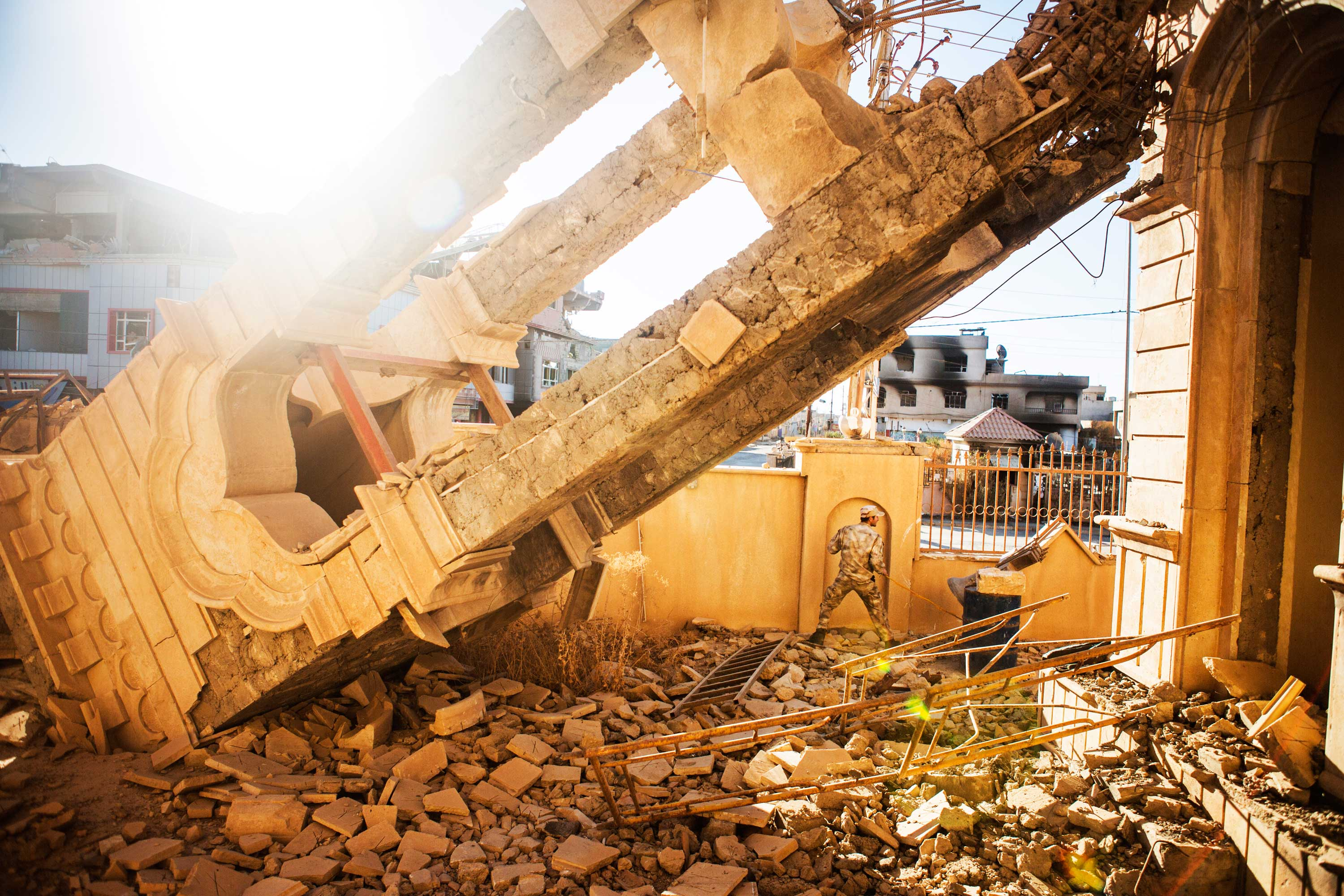 The tower bell of Saint Banham and Saint Sara Church, an Aramean Syrian Catholic Church, destroyed by ISIS. An Iraqi soldier is ringing the bell, which fell down in the tower's destruction.
