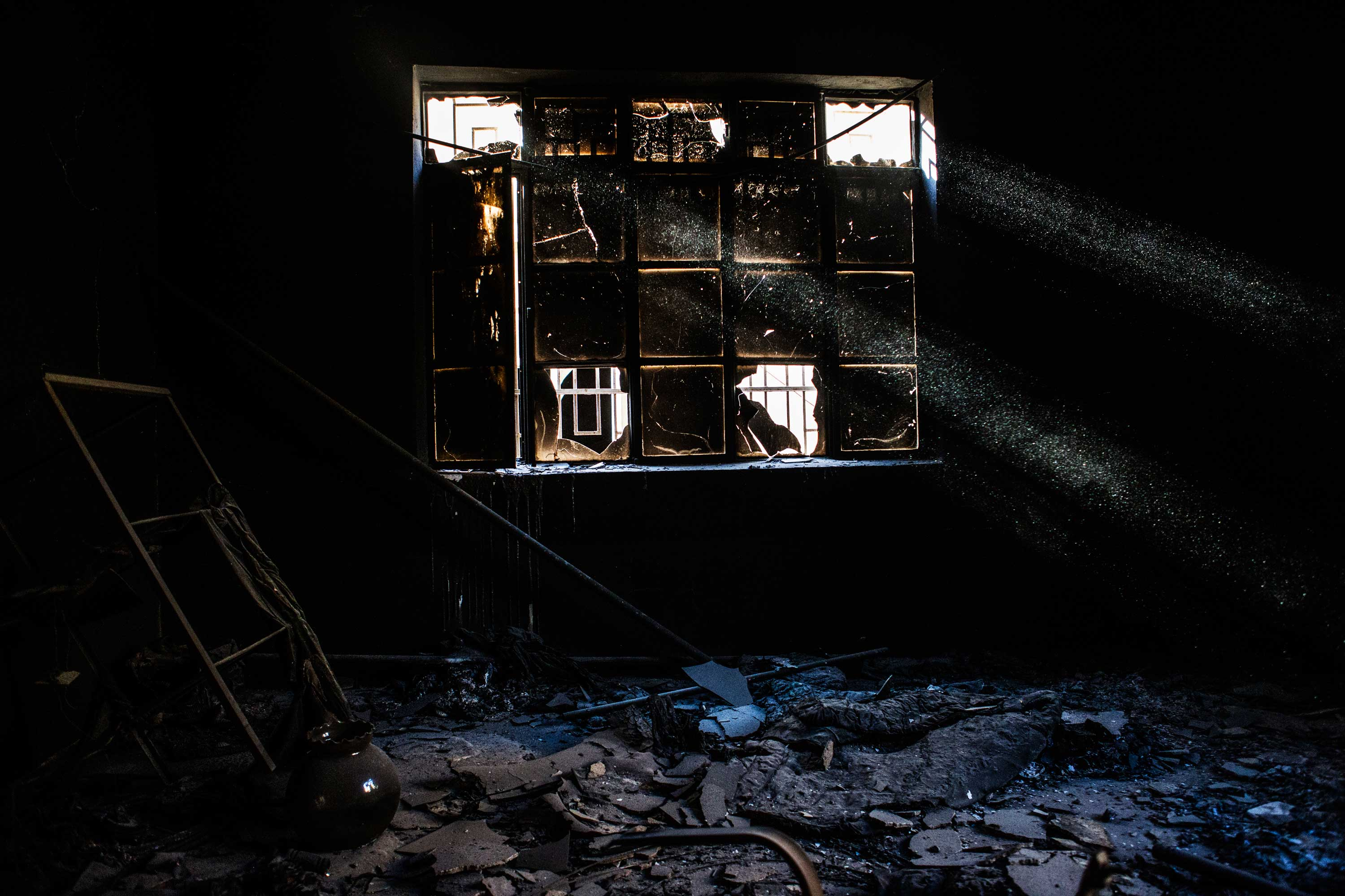 The remains of a room inside a house in Qaraqosh.
