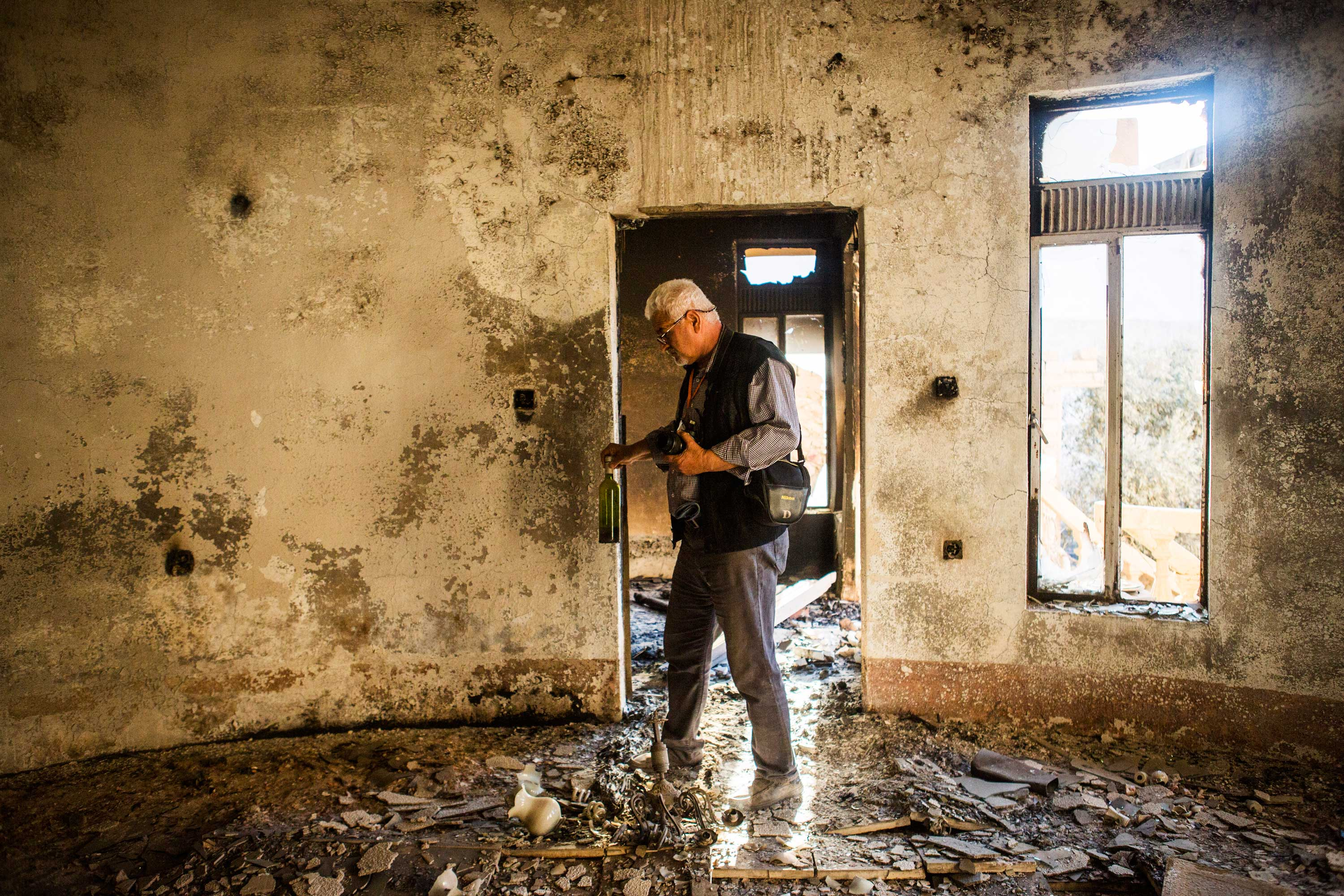 Aimad, 55, photographer from Qaraqosh. His house and his studio were totally destroyed.