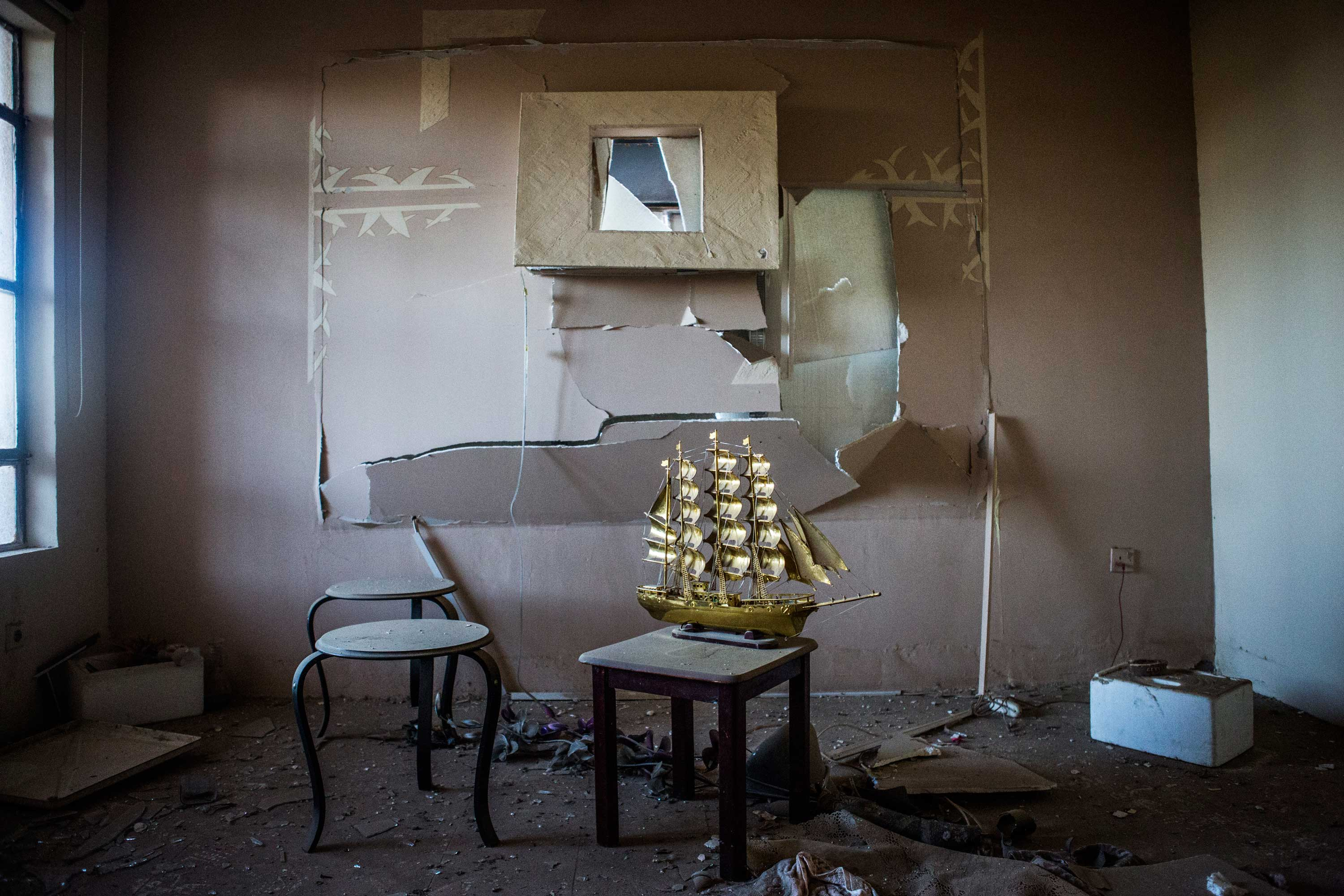 A caravel left intact in a living ransacked room.