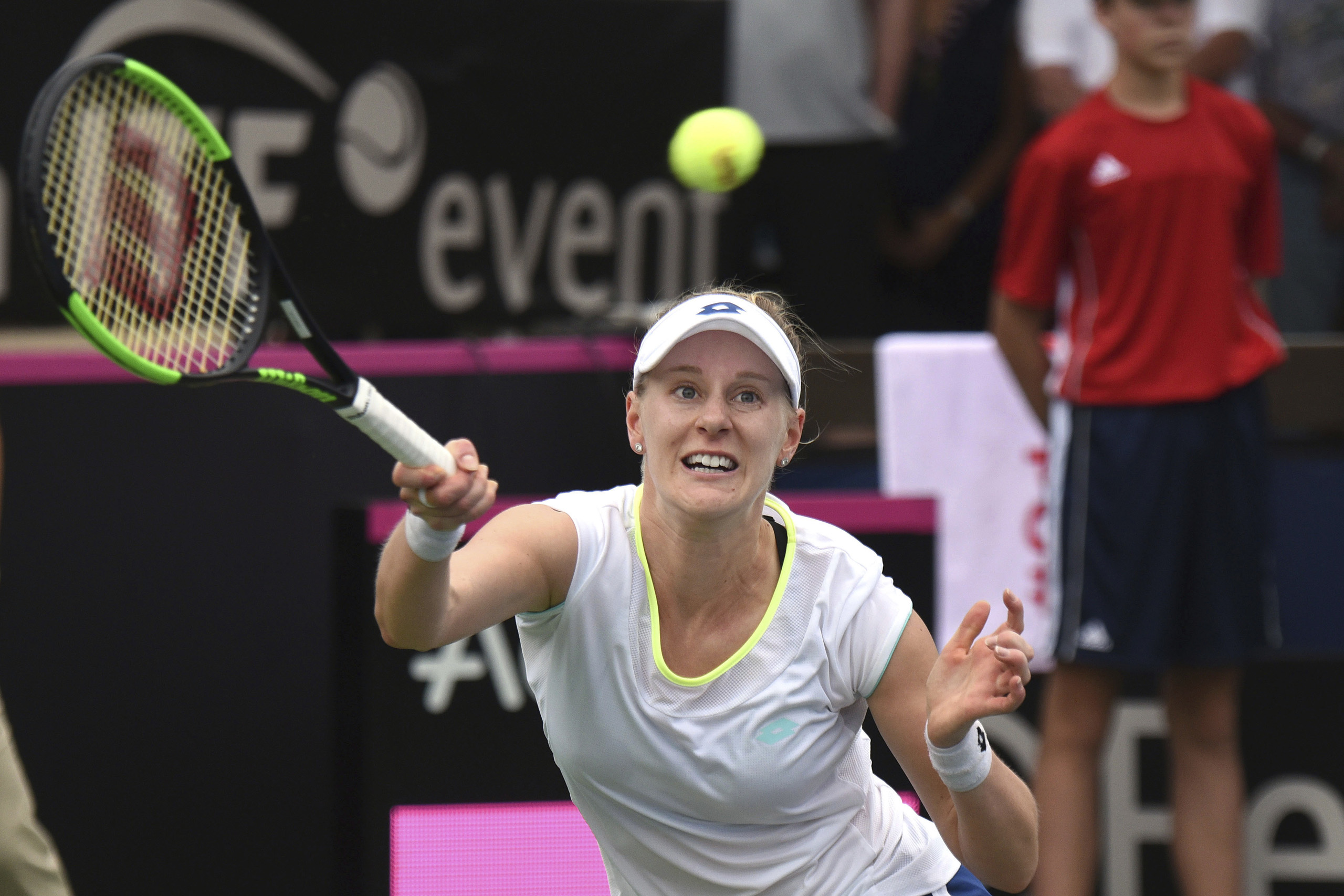 United States' Alison Riske returns to Germany's Andrea Petkovic in a Fed Cup tennis quarterfinal in Lahaina, Hawaii, Saturday, Feb. 11, 2017.