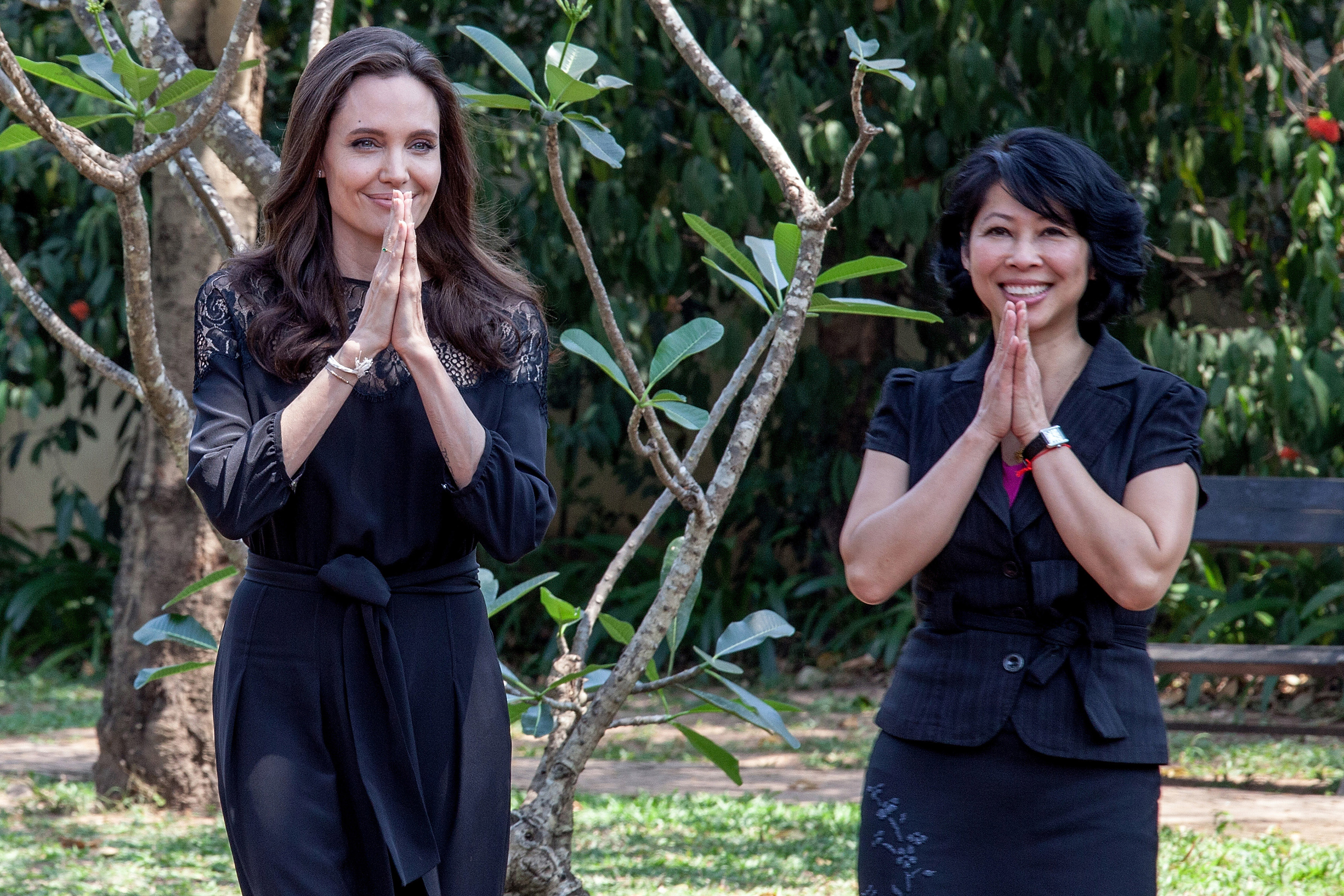 Angelina Jolie and author Loung Ung greet during their arrival at a press conference ahead of the premiere of their new film  First They Killed My Father  set up at the Raffles Grand Hotel D'Angkor in Siem Reap, Cambodia, on Febr. 18, 2017.