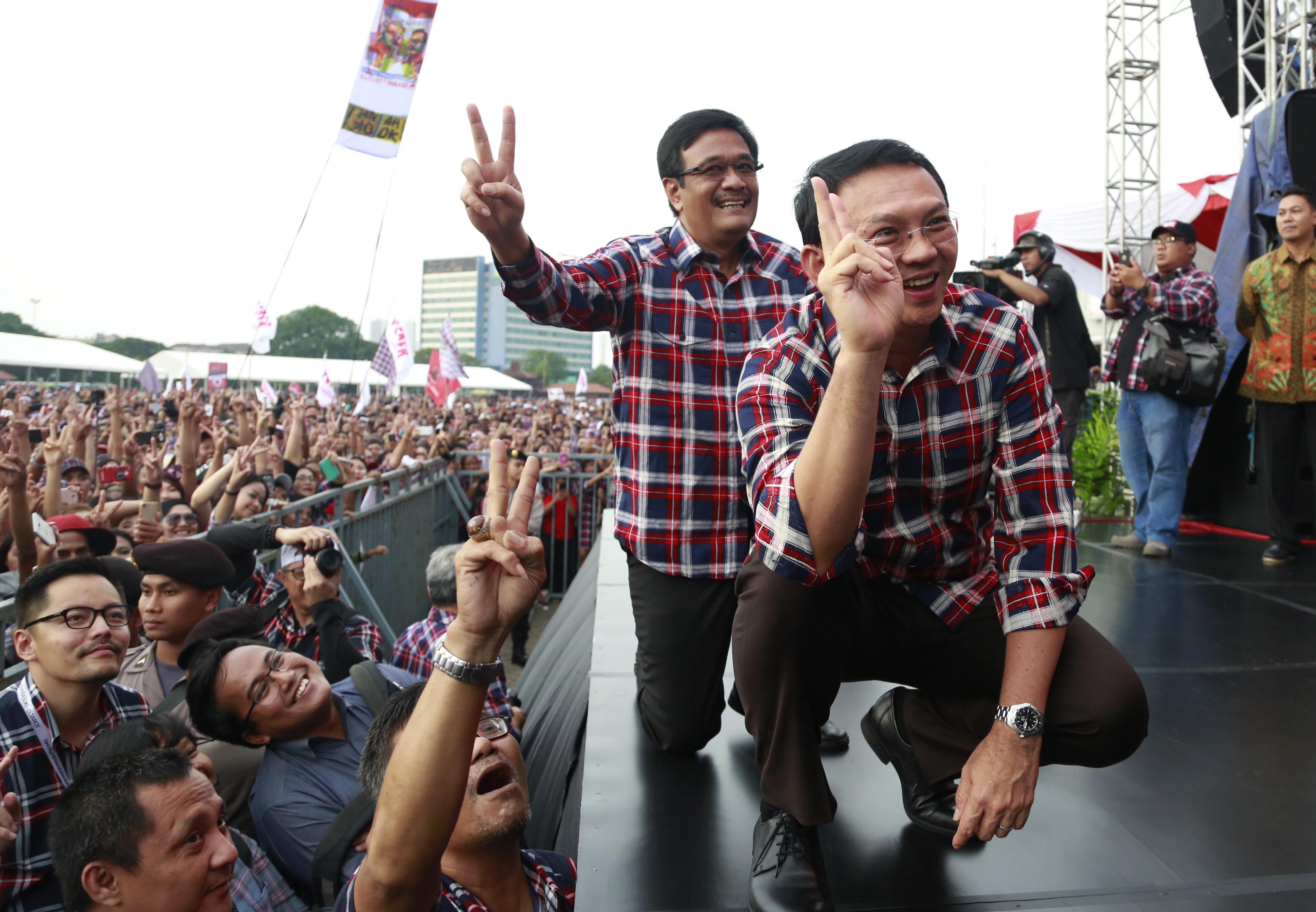 Jakarta Governor Basuki Tjahaja Purnama, also known as Ahok, right, and his deputy and also running mate, Djarot Saiful Hidayat, pose for photographers as they attend a campaign rally in Jakarta on Feb. 11, 2017