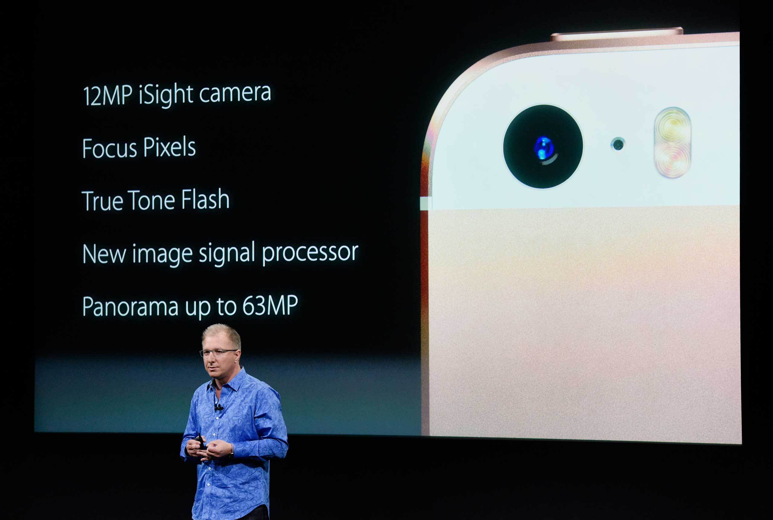 Greg Joswiak, vice president of iPod, iPhone, and iOS product marketing for Apple Inc., announces the iPhone SE smartphone during an Apple event in Cupertino, Calif., on March 21, 2016.