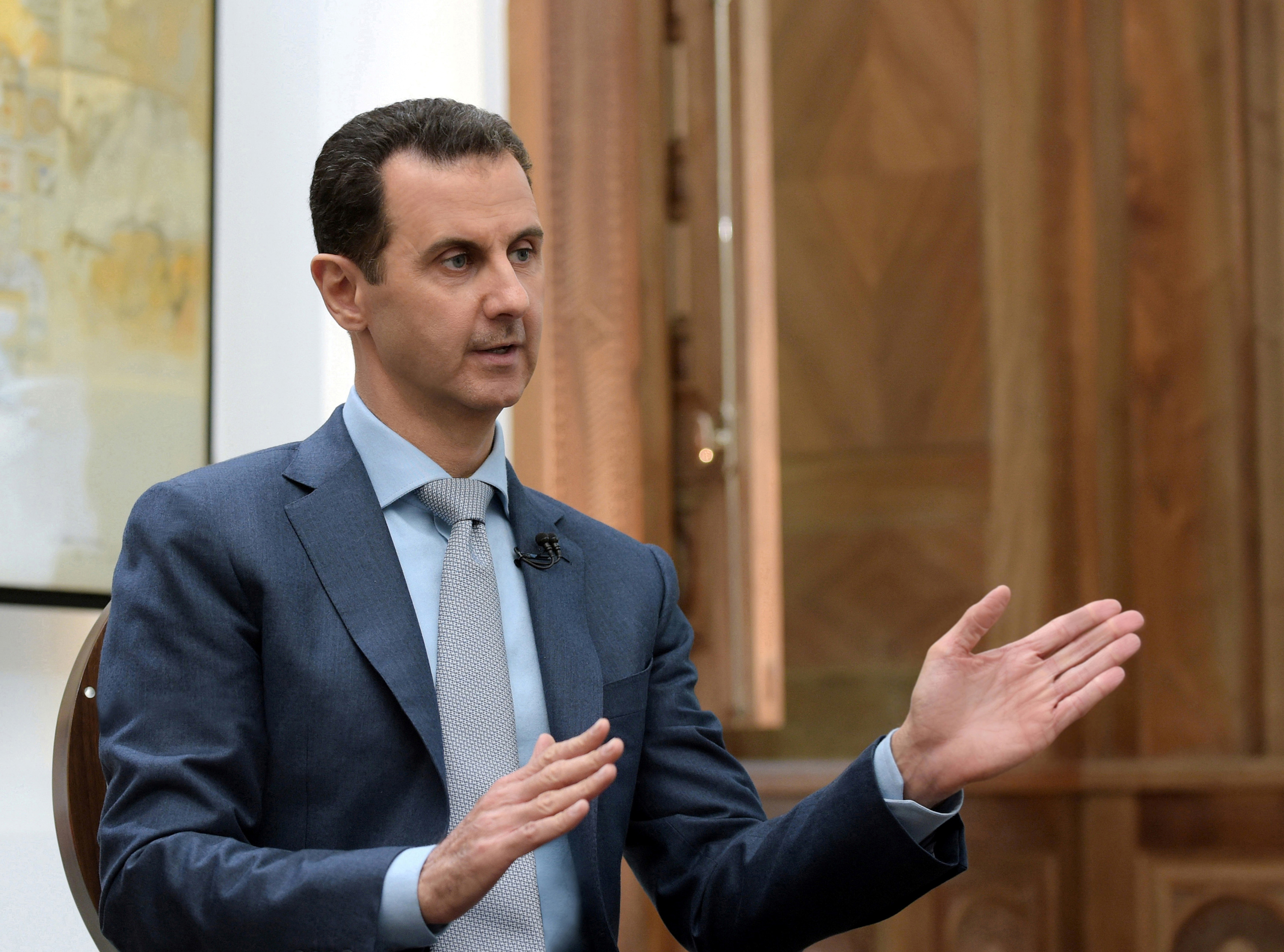 Syria's President Bashar al-Assad speaks during an interview with Yahoo News in this handout picture provided by SANA on Feb. 10, 2017.