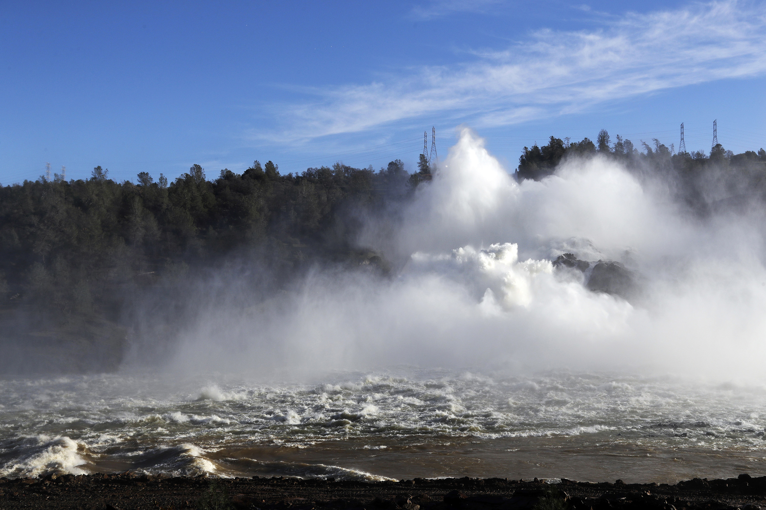Water gushes from the Oroville Dam's main spillway in Oroville, Calif. on Feb. 14, 2017.