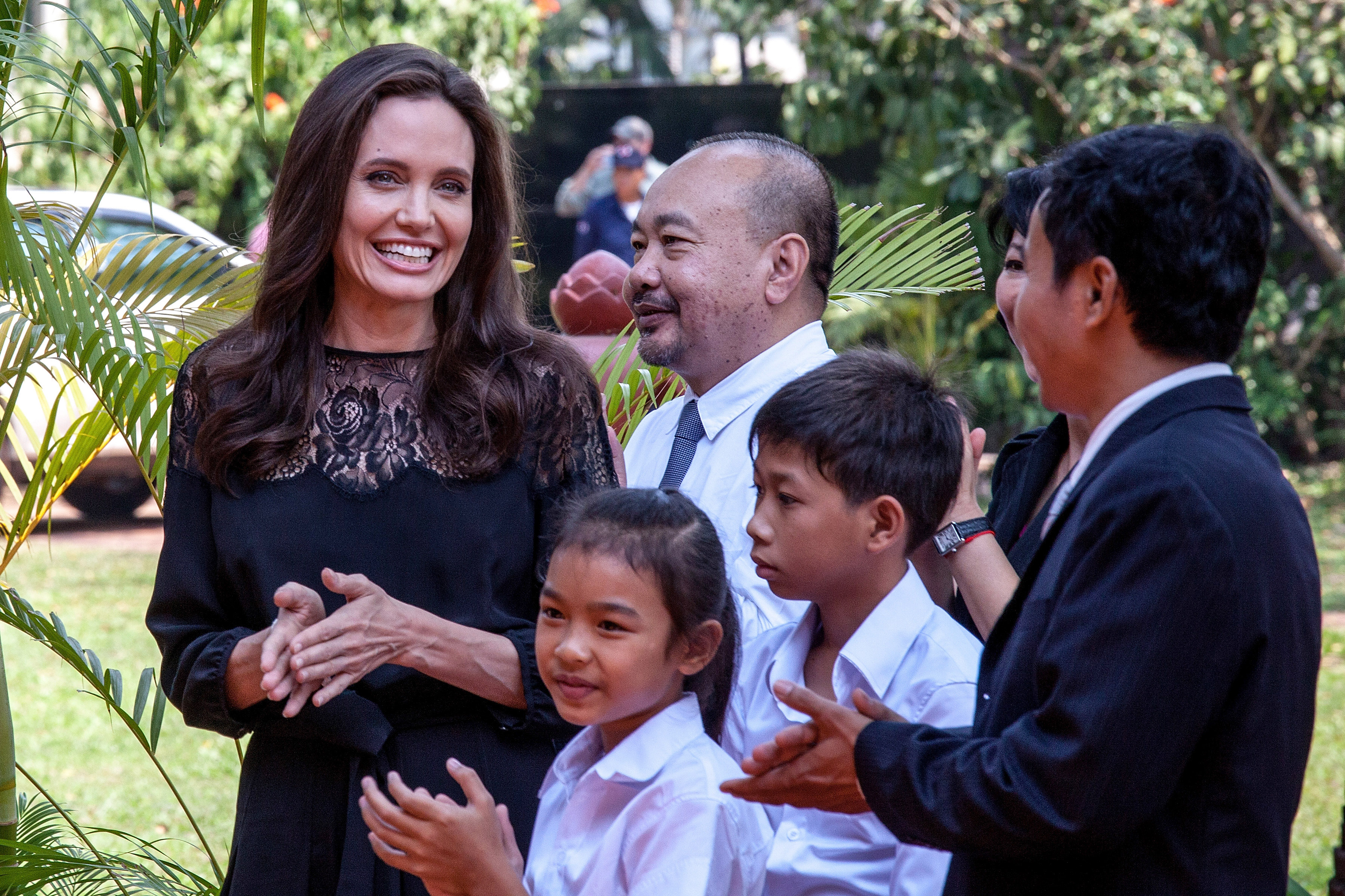 Angelina Jolie and producer Rithy Panh (center) chat with actors before holding a press conference ahead of the premiere of their new film  First They Killed My Father , on Feb. 18, 2017 in Siem Reap, Cambodia.
