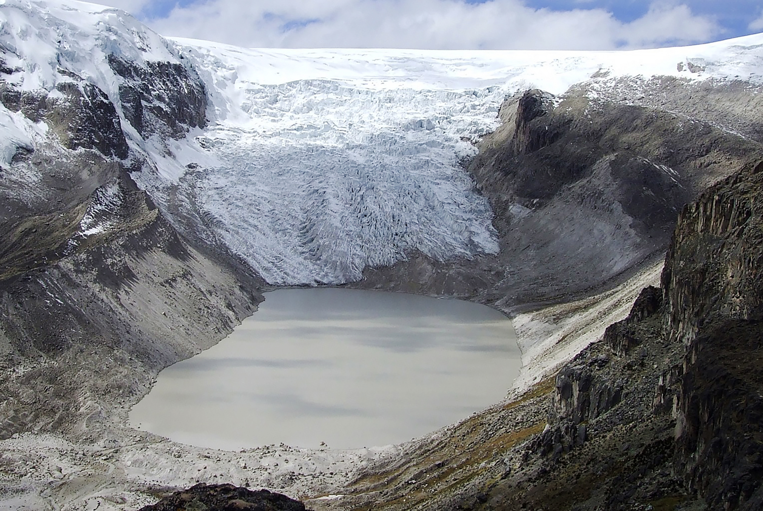 NASA images show Qori Kalis (above), a glacier that is part of the world's largest tropical ice cap, on a plateau 18,670 ft. (5,691 m) high in the Andes Mountains of Peru. In 1978, the glacier was still expanding. But not anymore. By 2011, it had retreated far enough to leave a lake 86 acres (35 hectares) in area and 200 ft. (60 m) deep. Human-influenced climate change has also contributed to the retreat of Muir and Riggs Glaciers (next pages), in Alaska.