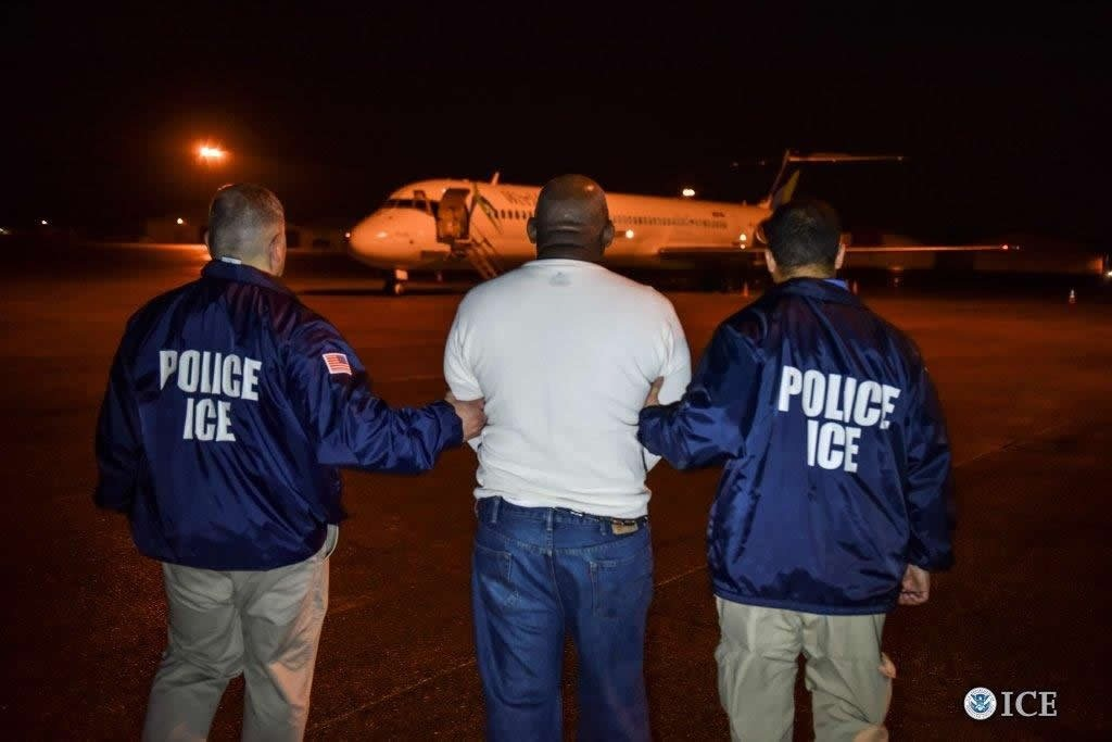 ICE handout photo shows one of hundreds of undocumented immigrants arrested during raids in 12 states.