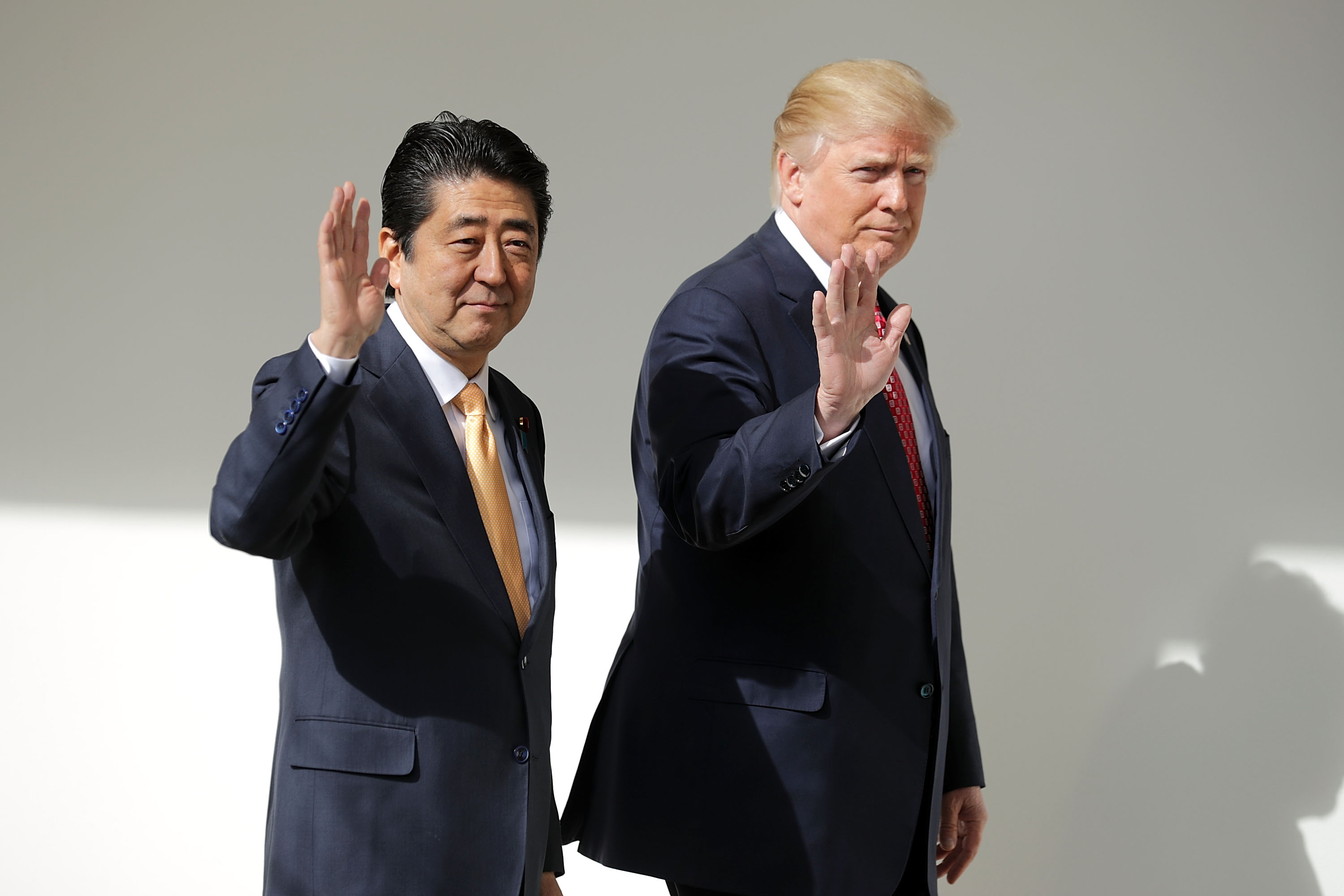 U.S. President Donald Trump and Japan Prime Minister Shinzo Abe walk together to their joint press conference in the East Room at the White House on Feb. 10, 2017 in Washington, D.C.