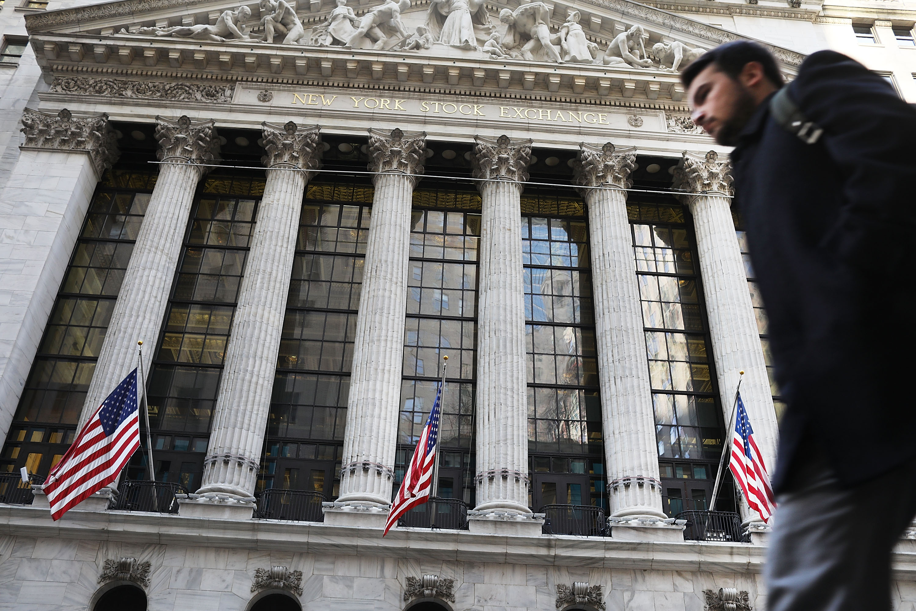 People walk by the New York Stock Exchange (NYSE) on Feb. 6, 2017 in New York City.