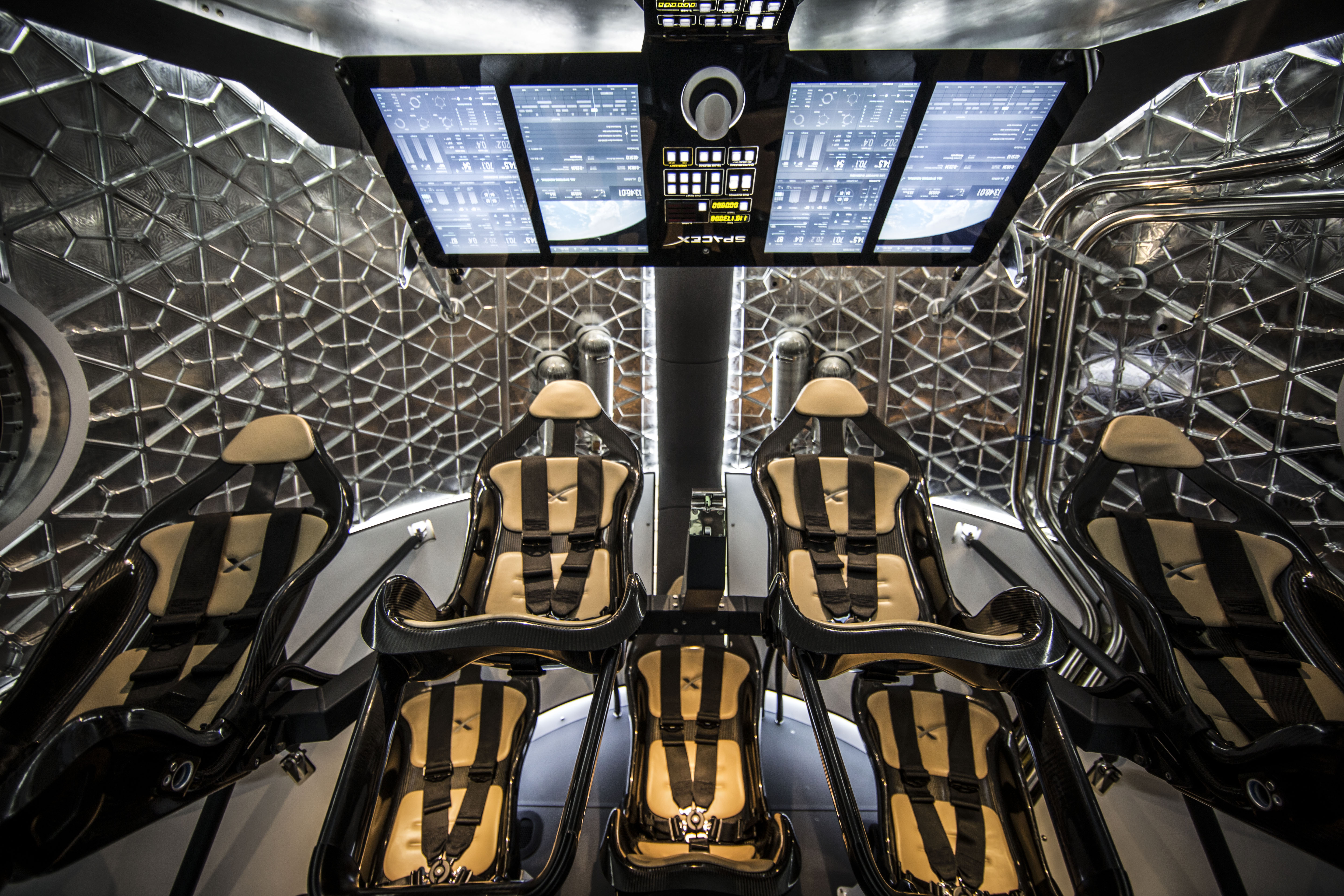 Sweet ride: The interior of SpaceX's Dragon spacecraft. For the first moon mission only two seats would be filled.