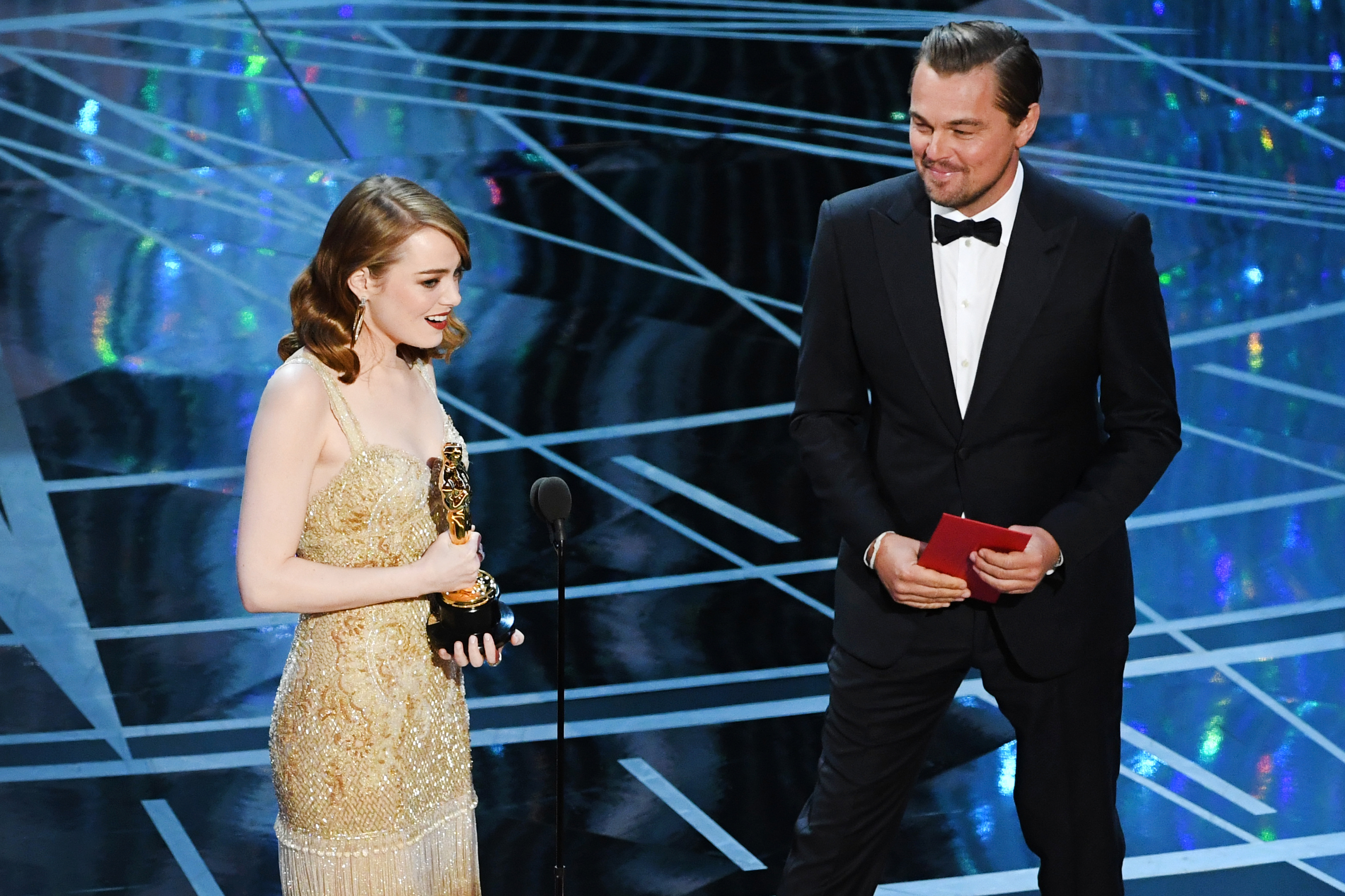 Emma Stone accepts Best Actress for La La Land from Leonardo DiCaprio during the 89th Annual Academy Awards, on Feb. 26, 2017 in Hollywood, Calif.