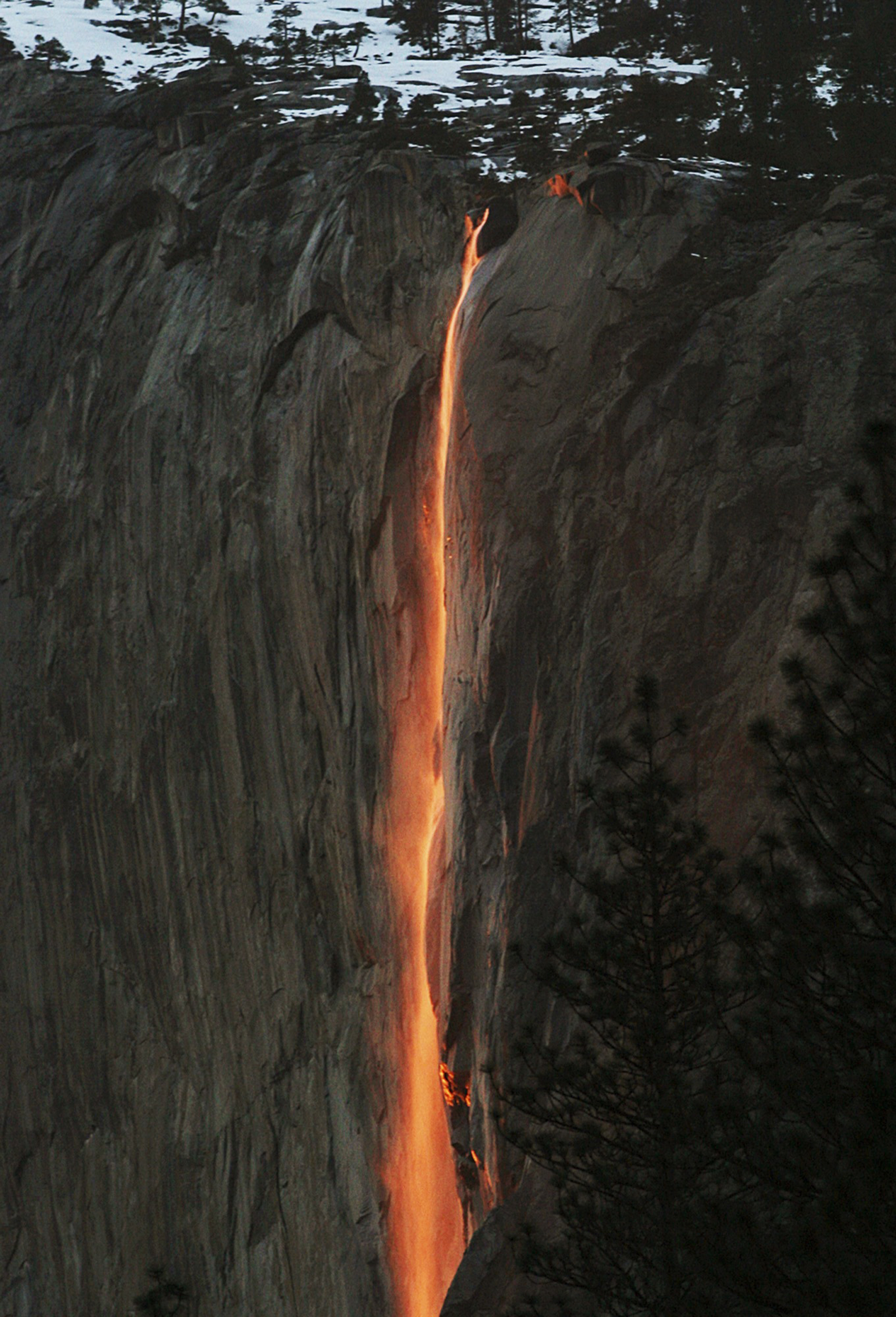 A shaft of sunlight creates a glow on the Horsetail waterfall in Yosemite National Park on Feb 16, 2010.