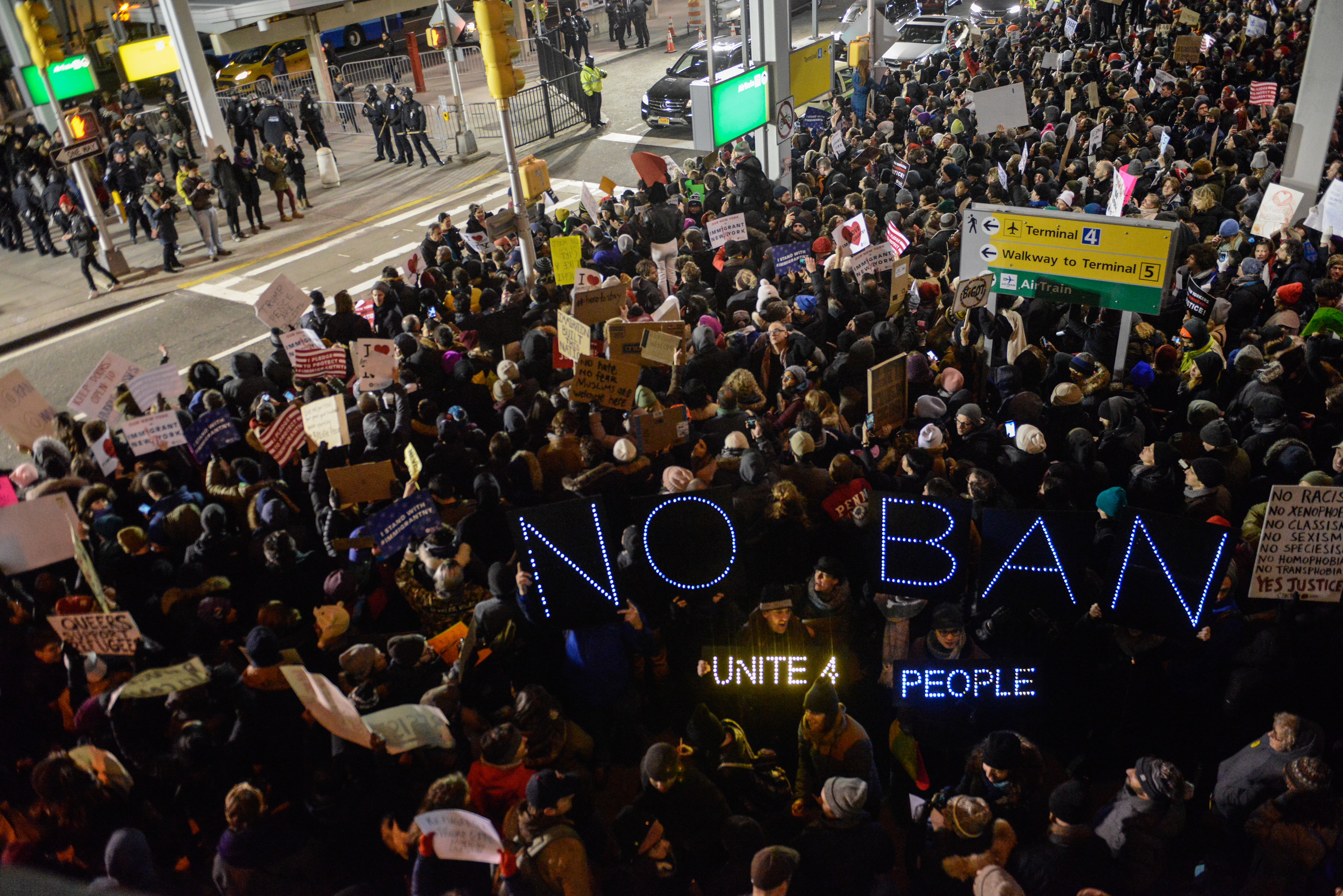 Protestors rally  during a demonstration against the immigration ban at John F. Kennedy International Airport on January 28, 2017 in New York City.