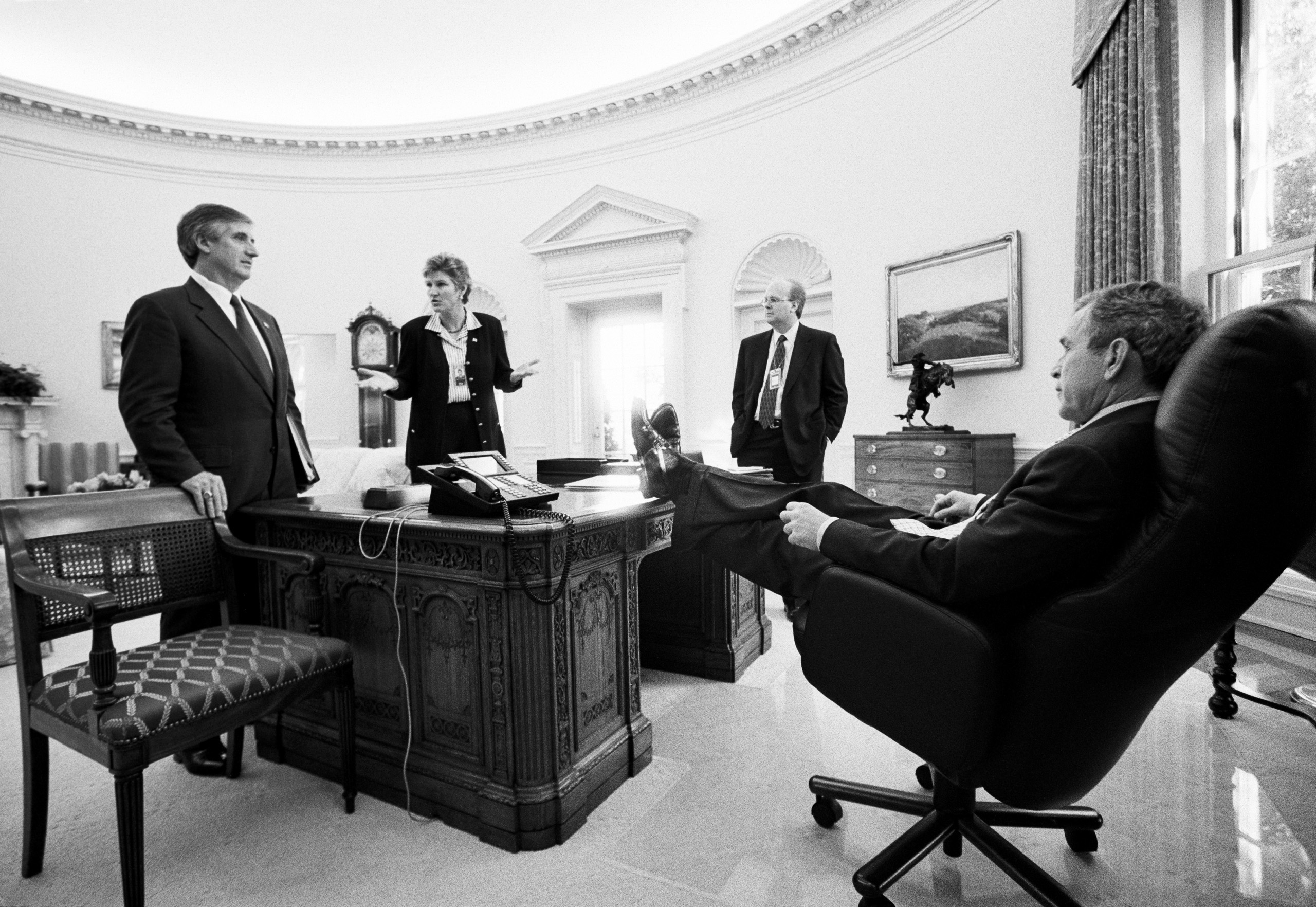 President George W. Bush meets with senior staff in the Oval Office to discuss policy. Left to right: Chief of Staff Andrew Card, Advisor Karen Hughes, and Senior Advisor to the President Karl Rove, Oct. 25, 2001.