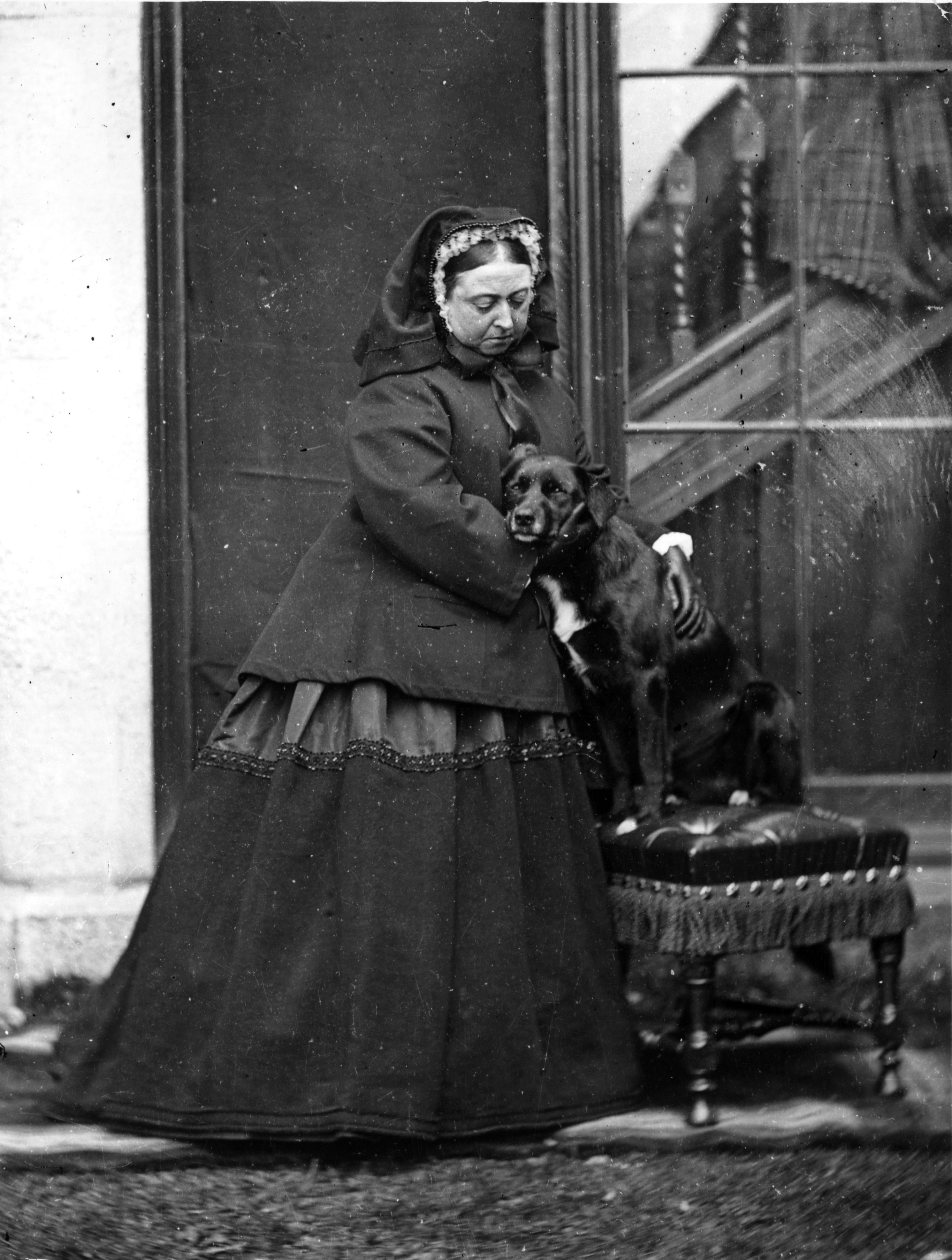 Queen Victoria of Great Britain with her pet dog 'Sharp' in 1867 at Balmoral Castle in Scotland.