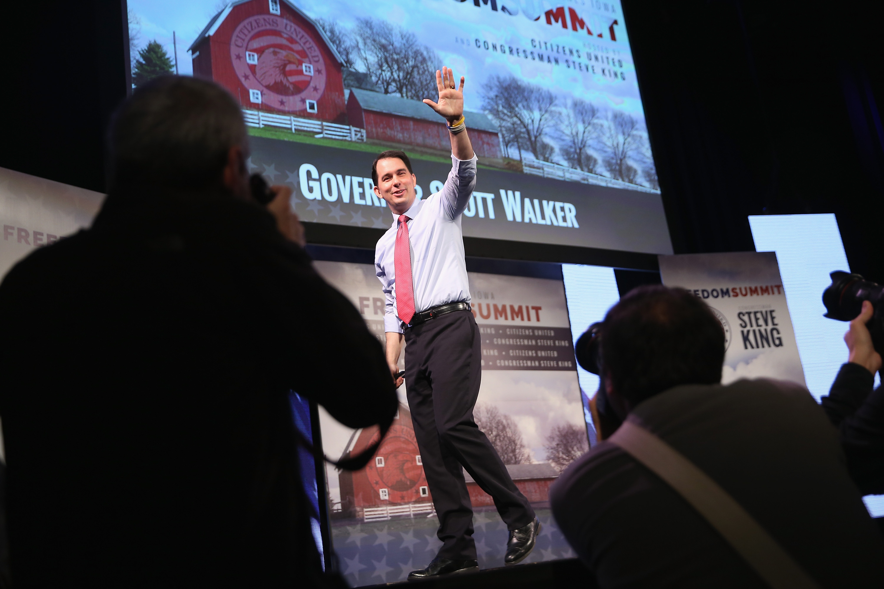 Wisconsin Gov. Scott Walker speaks to guests at the Iowa Freedom Summit on January 24, 2015 in Des Moines, Iowa. The summit is hosting a group of potential 2016 Republican presidential candidates to discuss core conservative principles ahead of the January 2016 Iowa Caucuses.  Scott Olson—Getty Images