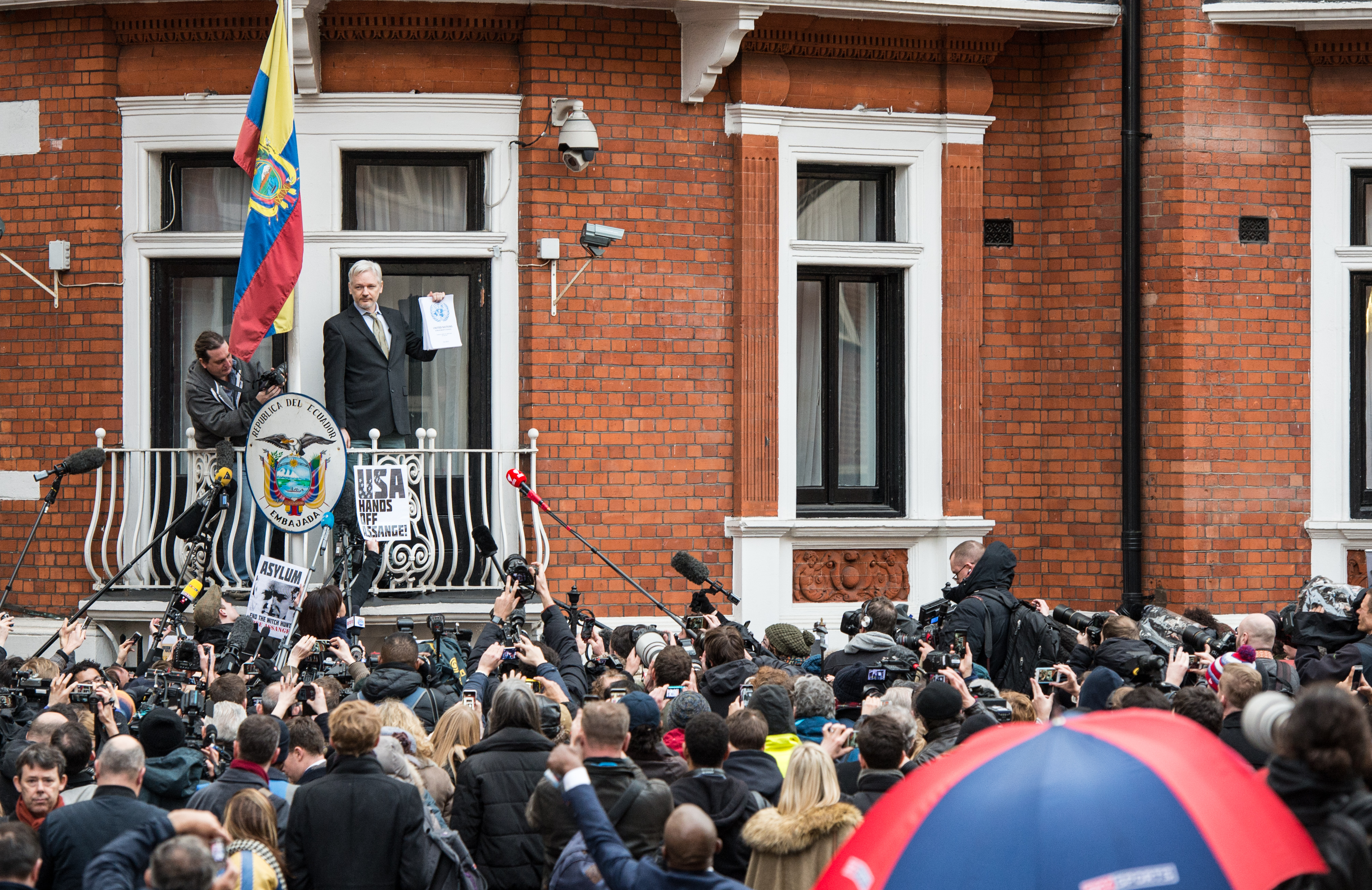 Wikileaks founder Julian Assange speaks from the balcony of the Ecuadorian embassy where  he continues to seek asylum following an extradition request from Sweden, on February 5, 2016 in London.