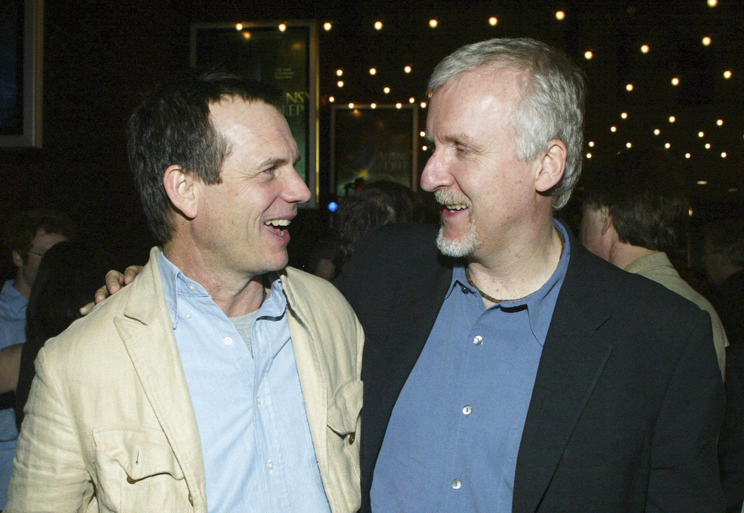 Bill Paxton (left) and James Cameron chat at the after party for the premiere of Aliens Of The Deep at the Universal City Walk IMAX theatre on January 20, 2004, in Universal City, California.