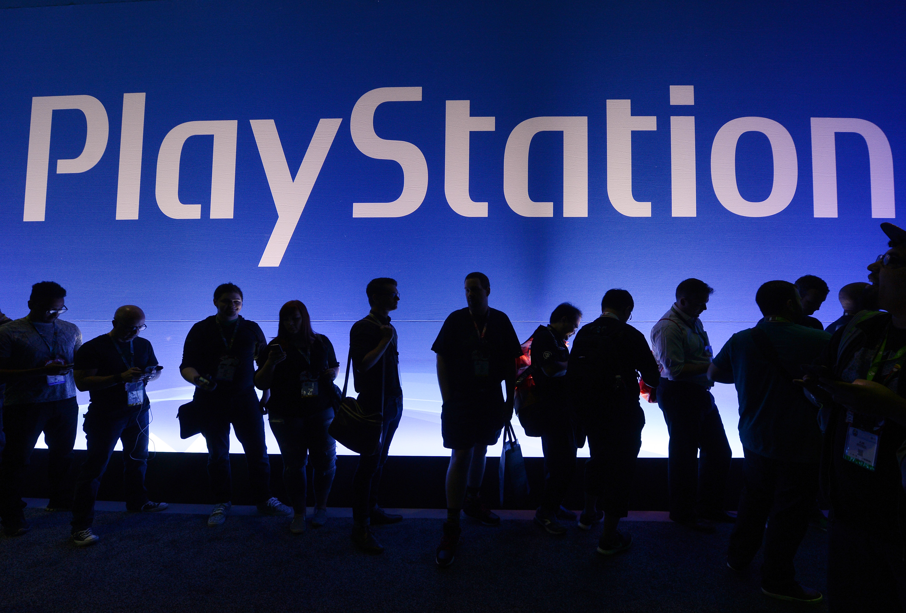 Gamers wait in line to enter Sony Playstation booth during the annual E3 2016 gaming conference at the Los Angeles Convention Center on June 14, 2016 in Los Angeles, California.