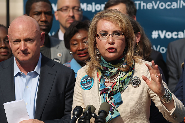 Gun violence victim and former U.S. Congresswoman Gabby Giffords speaks next to her husband, NASA astronaut Mark Kelly, as they visits City Hall on her 2016 Vocal Majority Tour on October 17, 2016 in New York City.