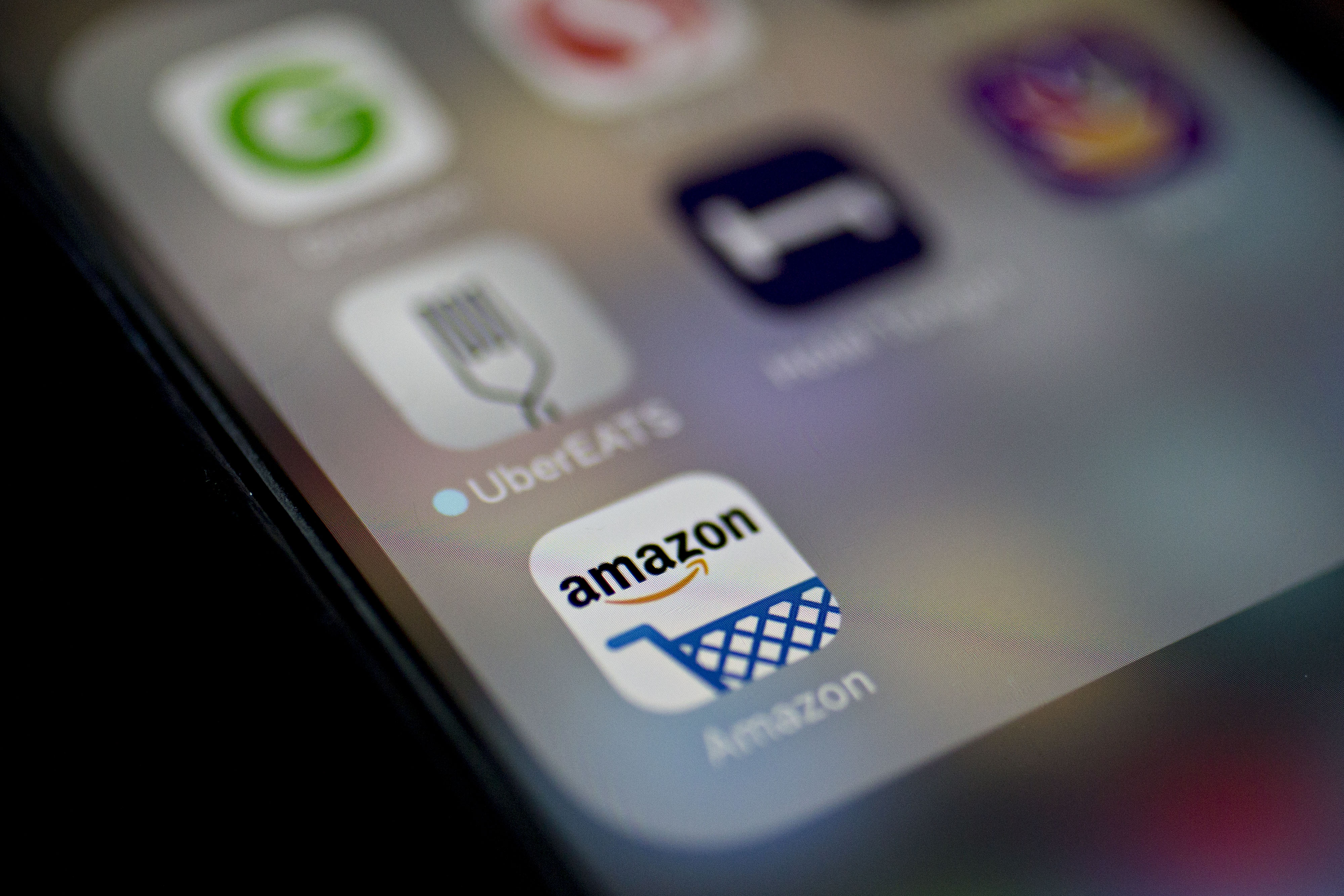 The Amazon.com Inc. application icon is displayed on an Apple Inc. iPhone in Washington, D.C., U.S., on Monday, Dec. 5, 2016.