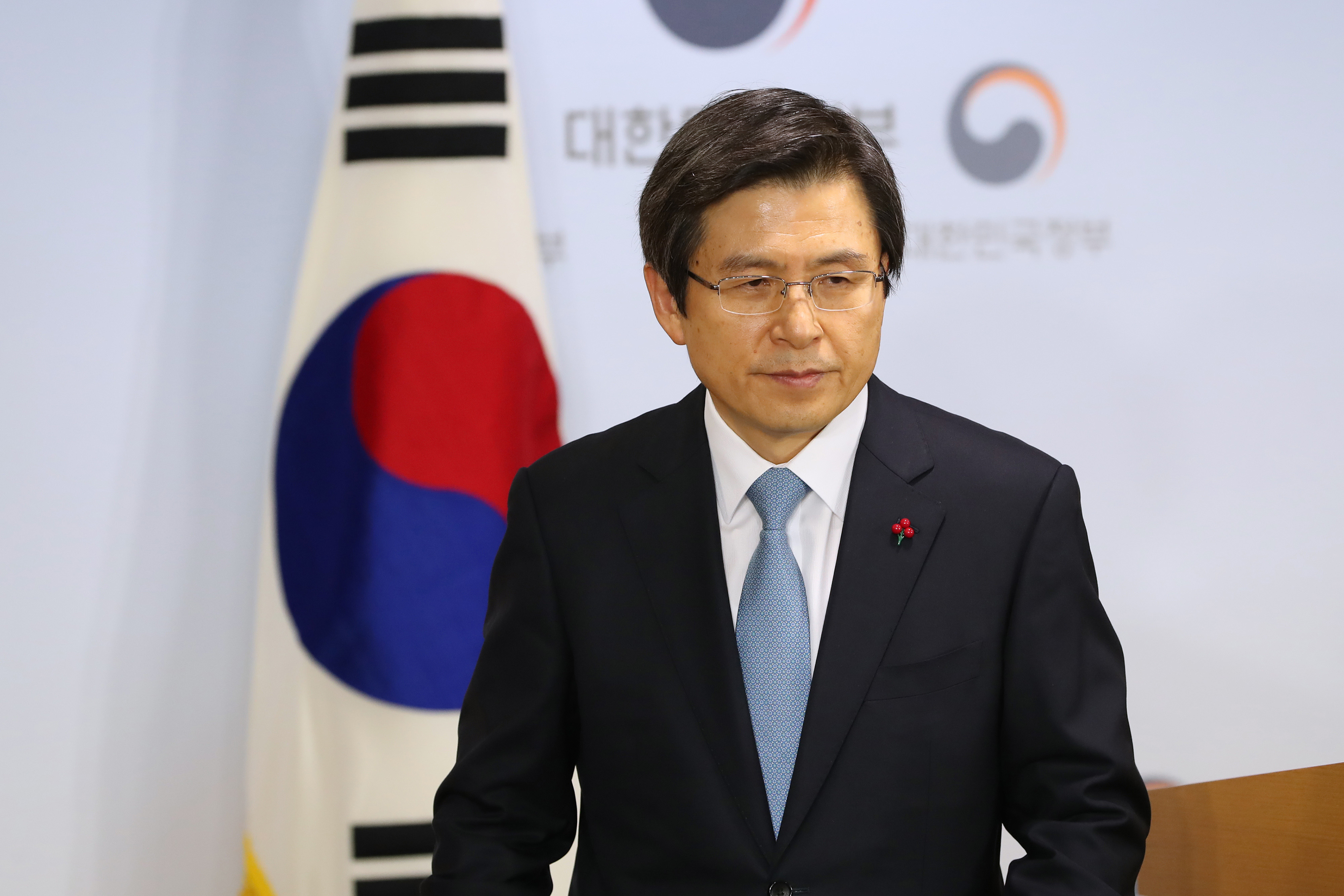 Hwang Kyo-ahn, South Korea's prime minister, departs a news conference in Seoul, South Korea, on Friday, Dec. 9, 2016.