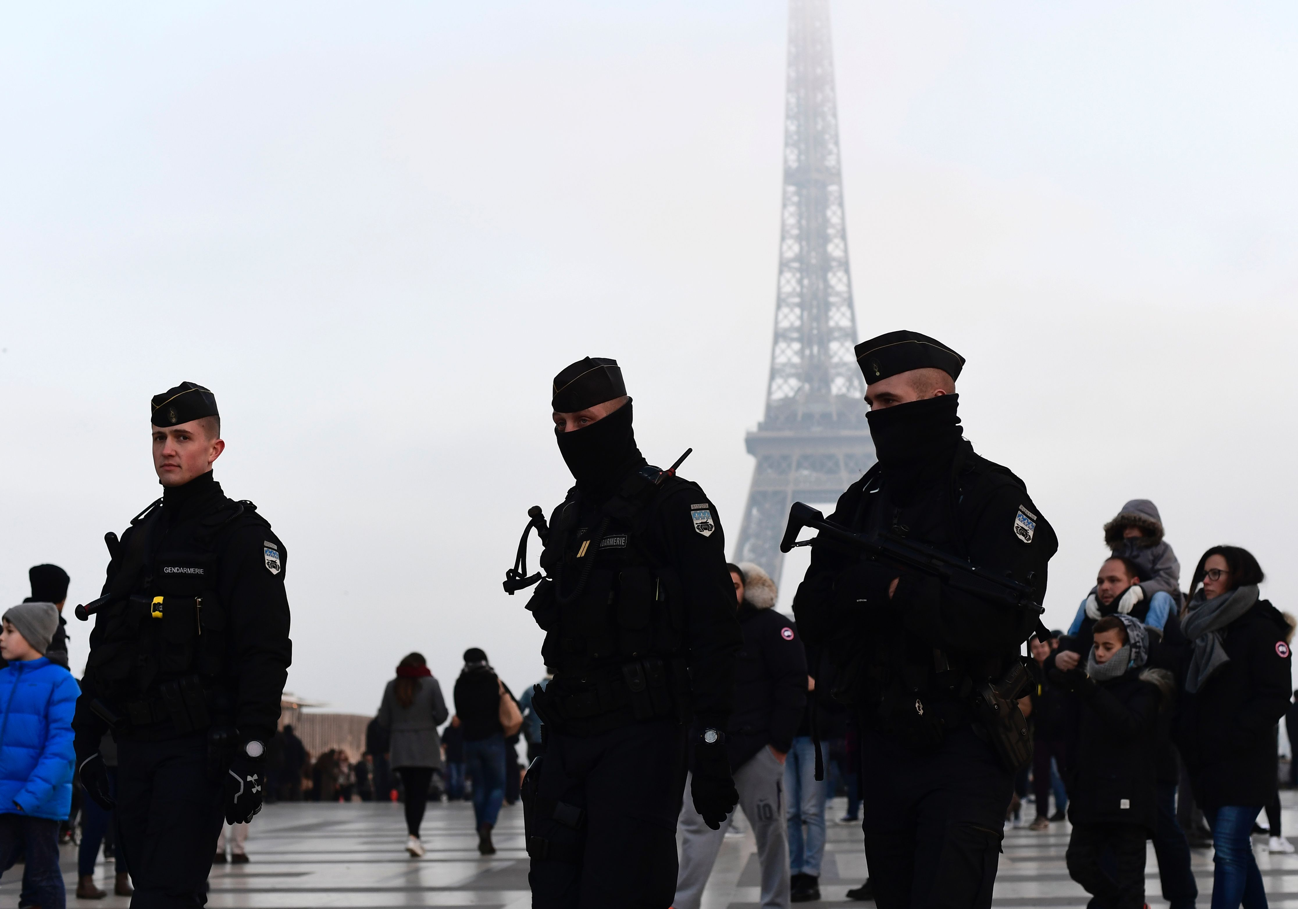 French gendarmes patrol in front of the Eiffel Tower in Paris on Dec. 30, 2016