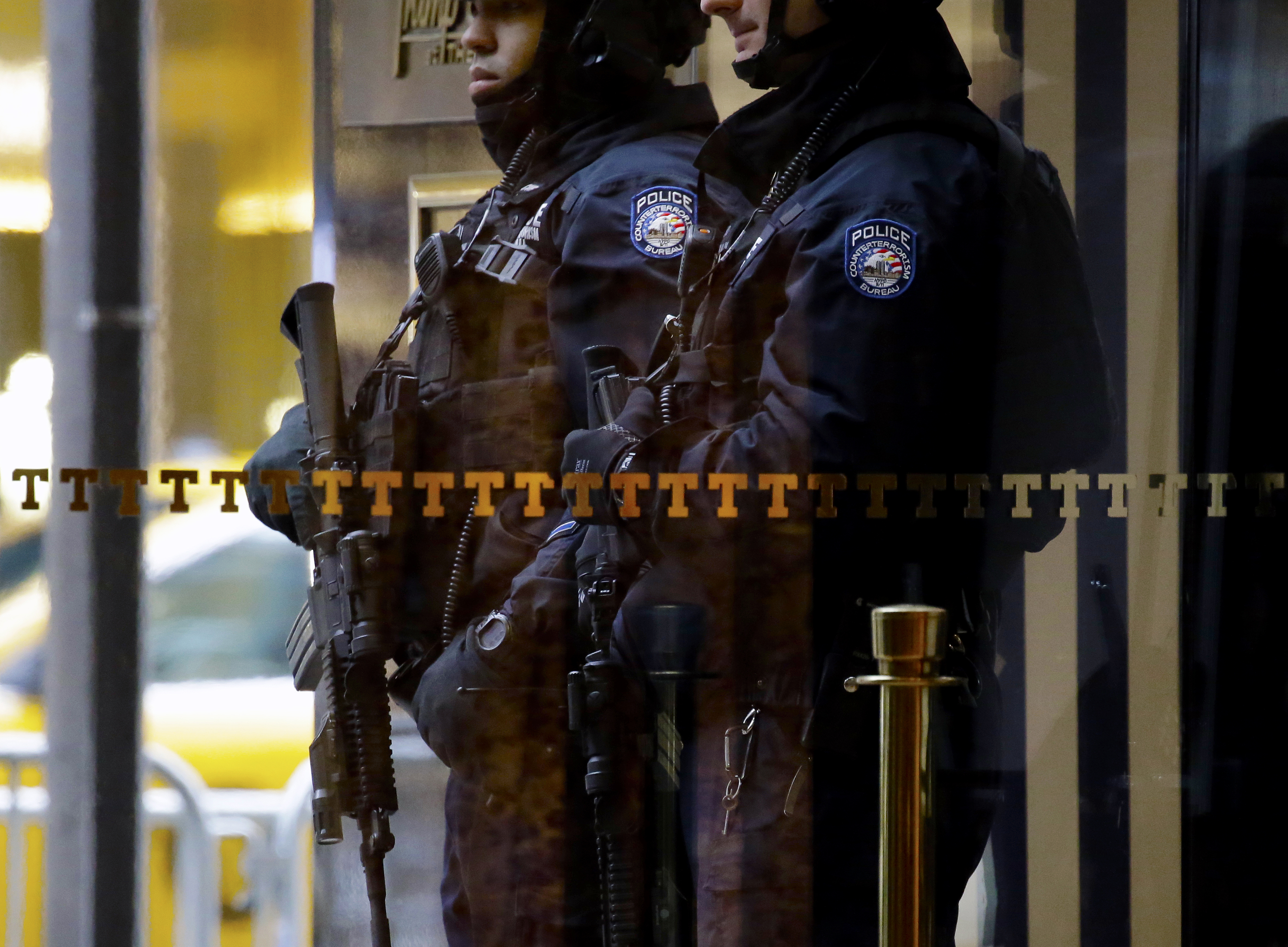 New York Police Department (NYPD) counterterrorism officers stand armed outside of Trump Tower in New York, on Jan. 2, 2017.