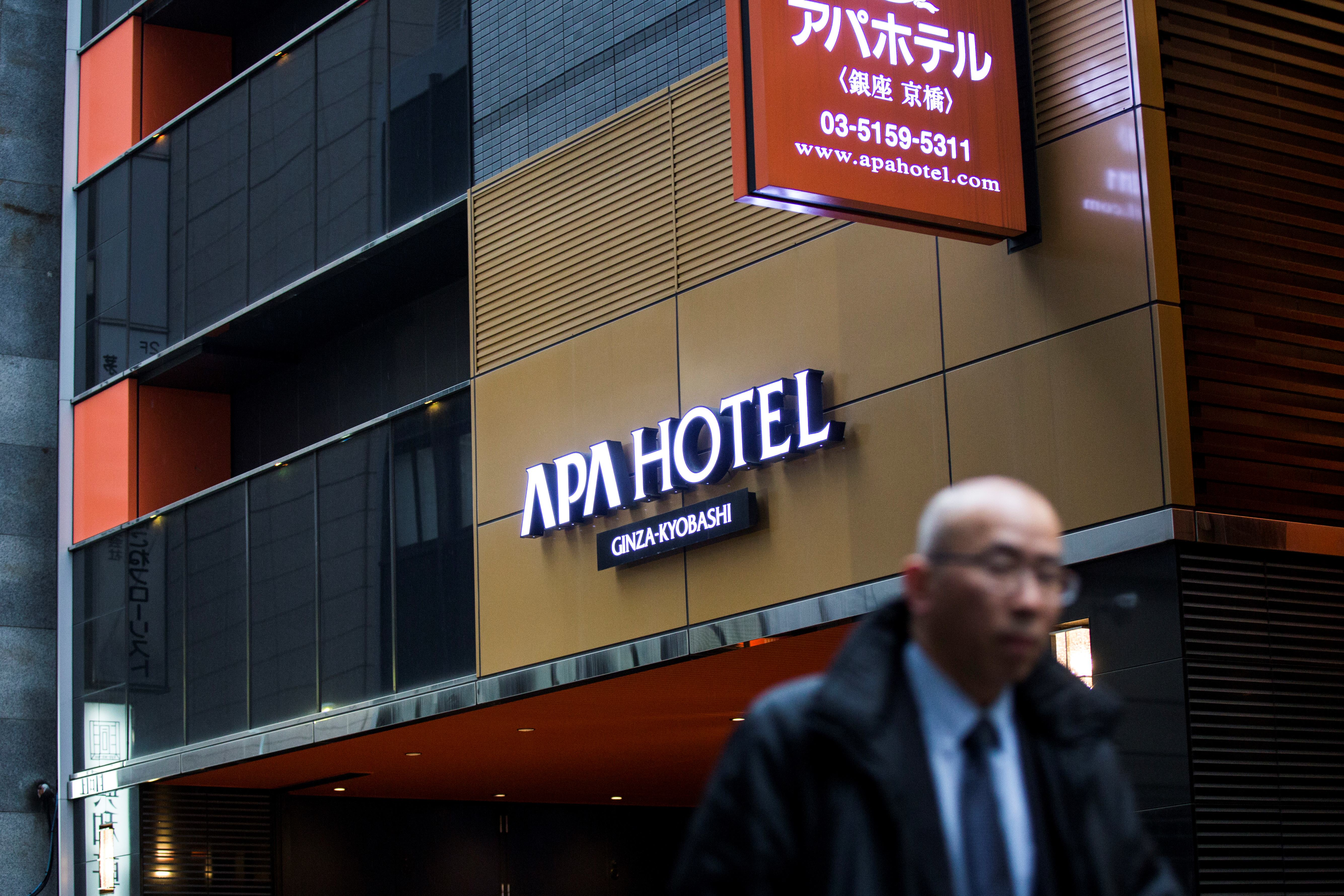 A man walks past the entrance of an APA hotel in central Tokyo on Jan. 20, 2017