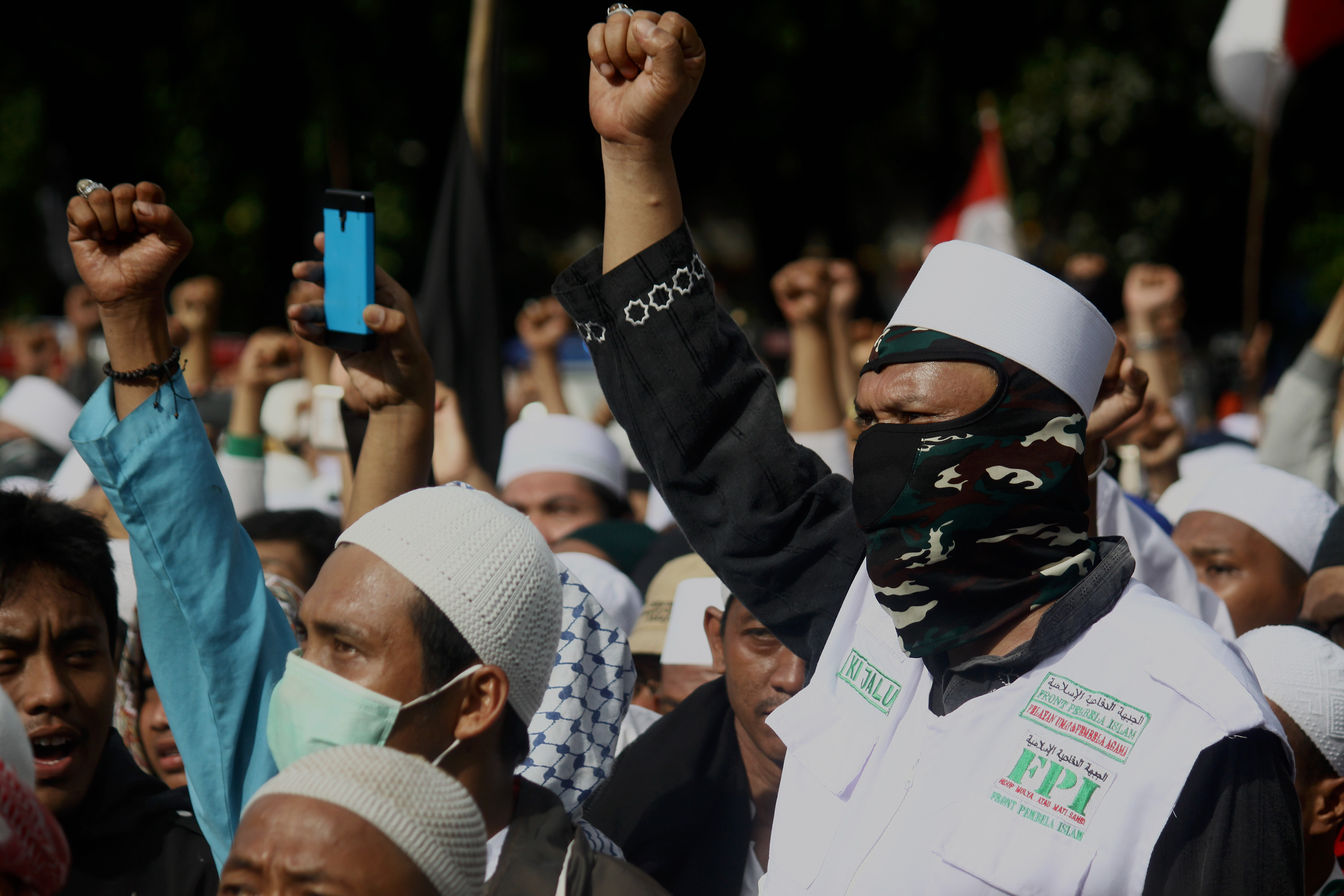 Thousands of Muslims hold a demonstration in front of the Jakarta Metropolitan Police Headquarters on Jan. 23, 2017, in Jakarta