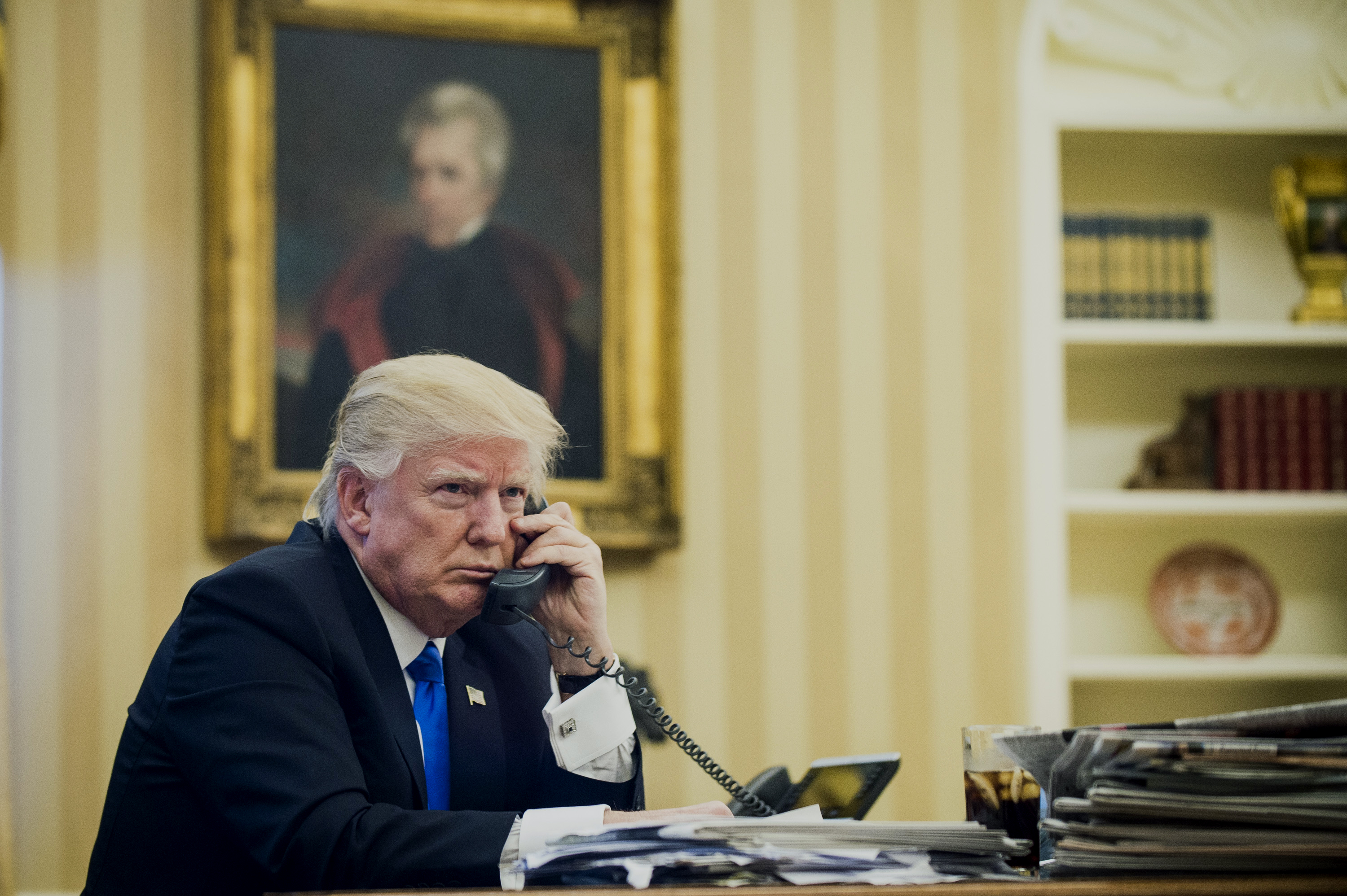 U.S. President Donald Trump speaks on the phone with Malcolm Turnbull, Australia's prime minister, during the first official phone talks in the Oval Office of the White House in Washington, D.C., U.S., on Saturday, Jan. 28, 2017.