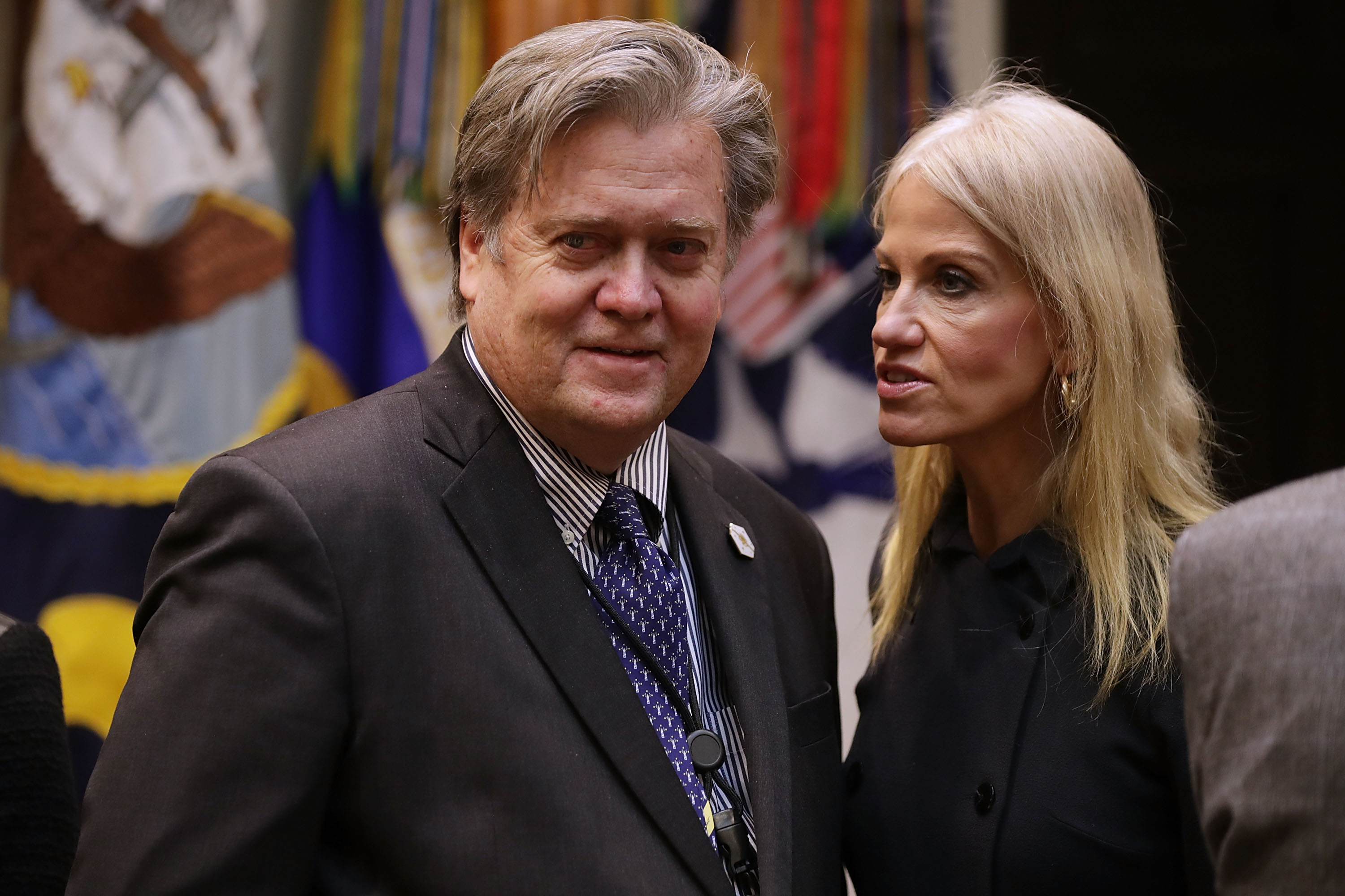 White House Chief Strategist Steve Bannon (L) and Counselor to the President Kellyanne Conway wait for the arrival of U.S. President Donald Trump for a meeting on cyber security in the Roosevelt Room at the White House January 31, 2017 in Washington, DC.