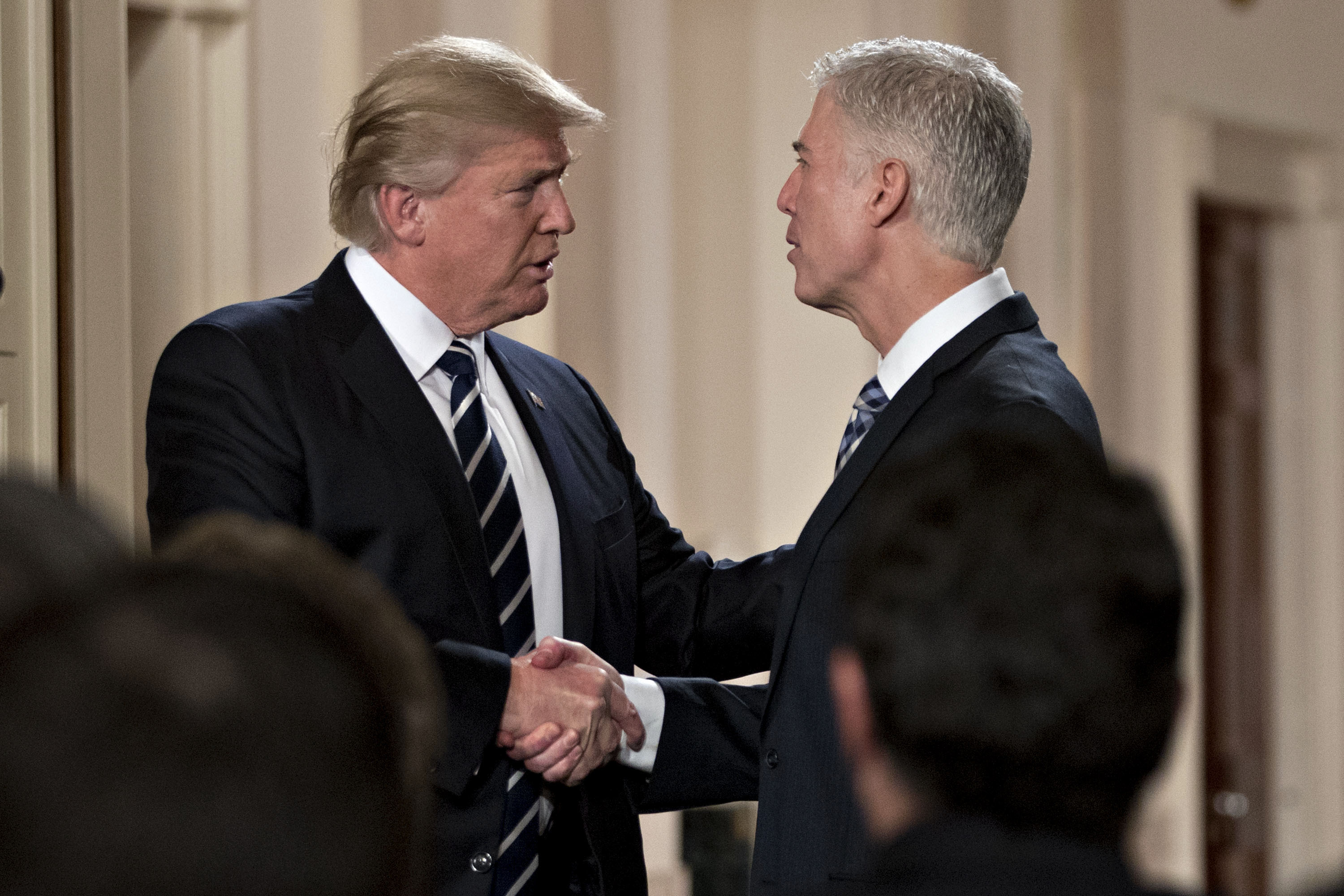 President Donald Trump shakes hands with Neil Gorsuch in the East Room of the White House in Washington, D.C., on Jan. 31, 2017.