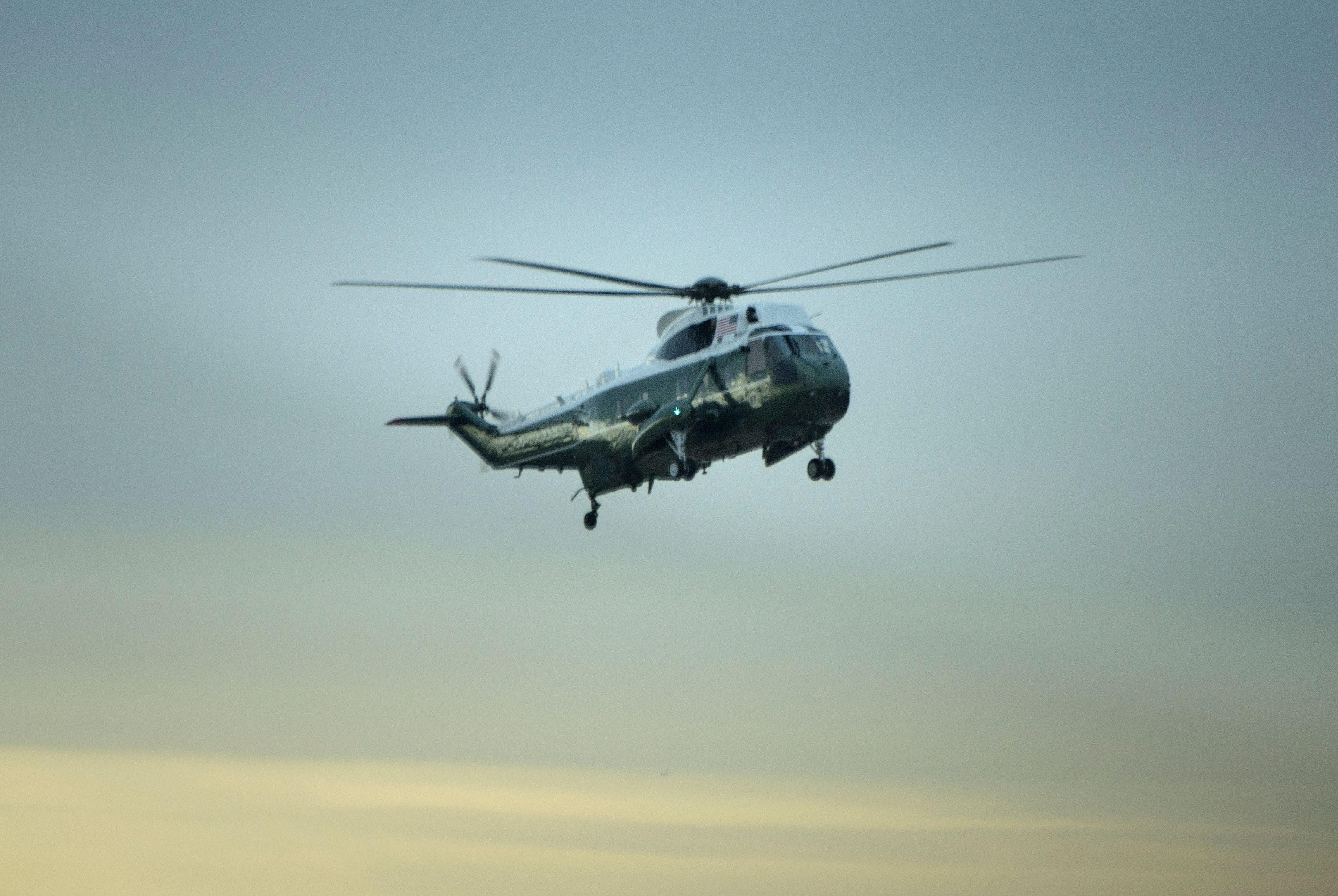 Marine One with President Trump on board, lands at Dover Air Force Base for the dignified transfer of Navy Seal Chief Petty Officer William  Ryan  Owens in Dover, Delaware on Feb. 1, 2017.