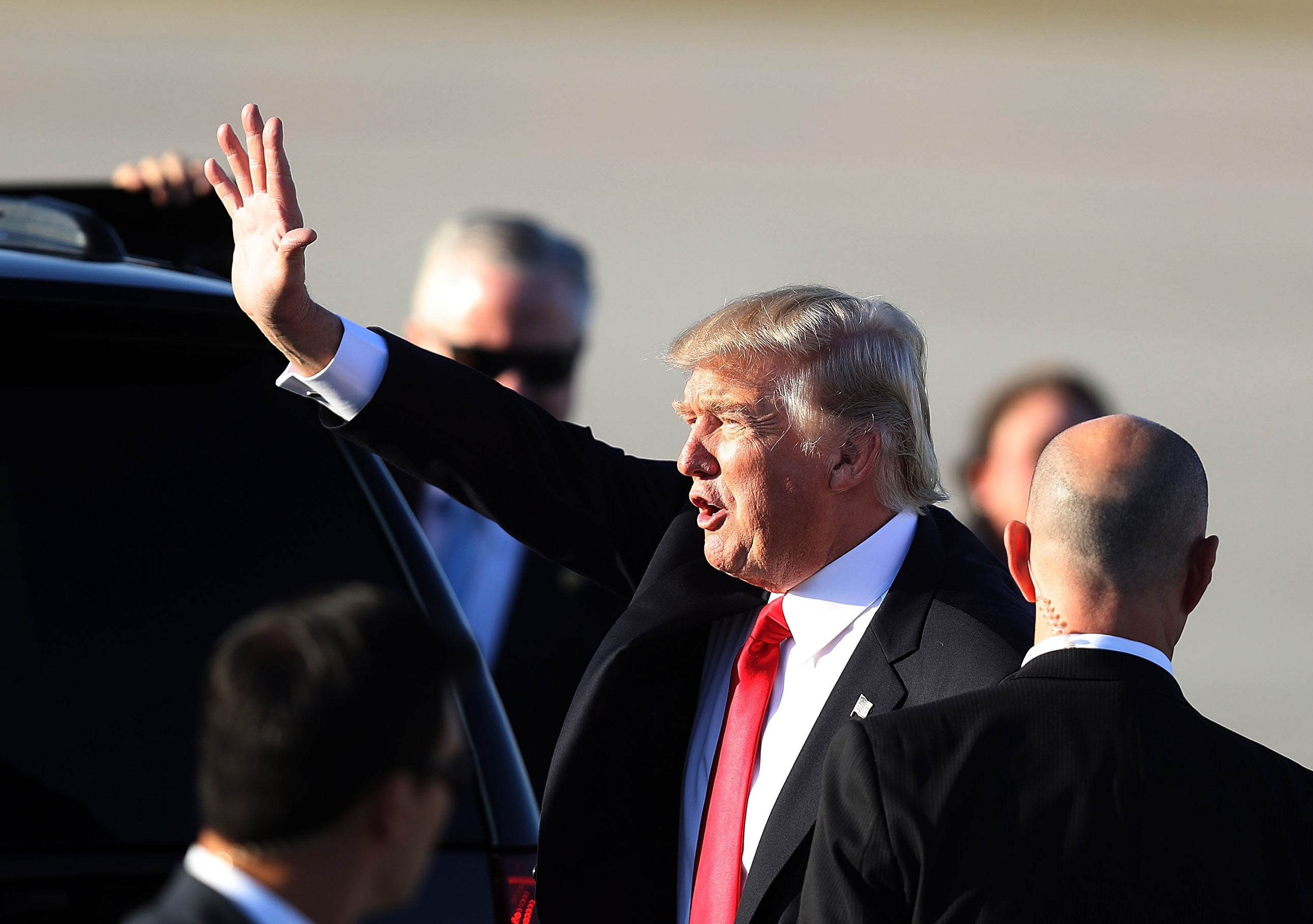 President Donald Trump waves to supporters after arriving on Air Force One at the Palm Beach International Airport for a visit to his Mar-a-Lago Resort for the weekend on February 3, 2017 in Palm Beach, Florida.