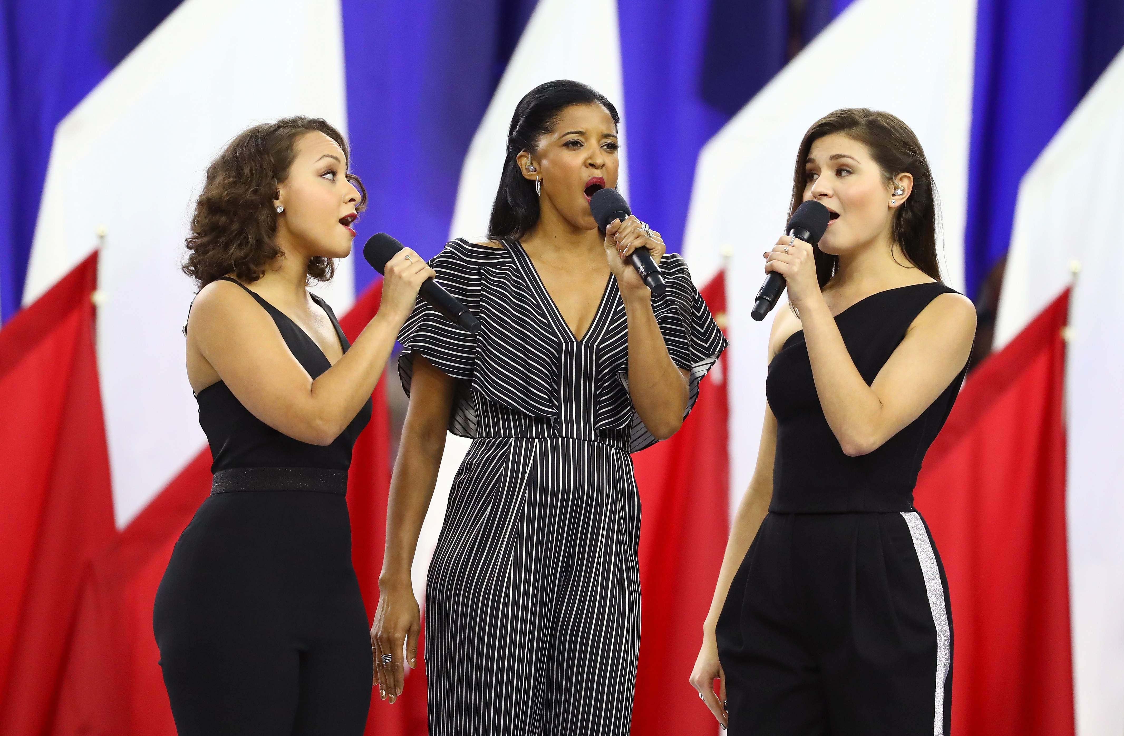 (L-R) Singers Jasmine Cephas Jones, Renee Elise Goldsberry and Phillipa Soo of the Broadway musical  Hamilton  sing  America, The Beautiful  prior to Super Bowl 51 between the Atlanta Falcons and the New England Patriots at NRG Stadium in Houston, TX on February 5, 2017