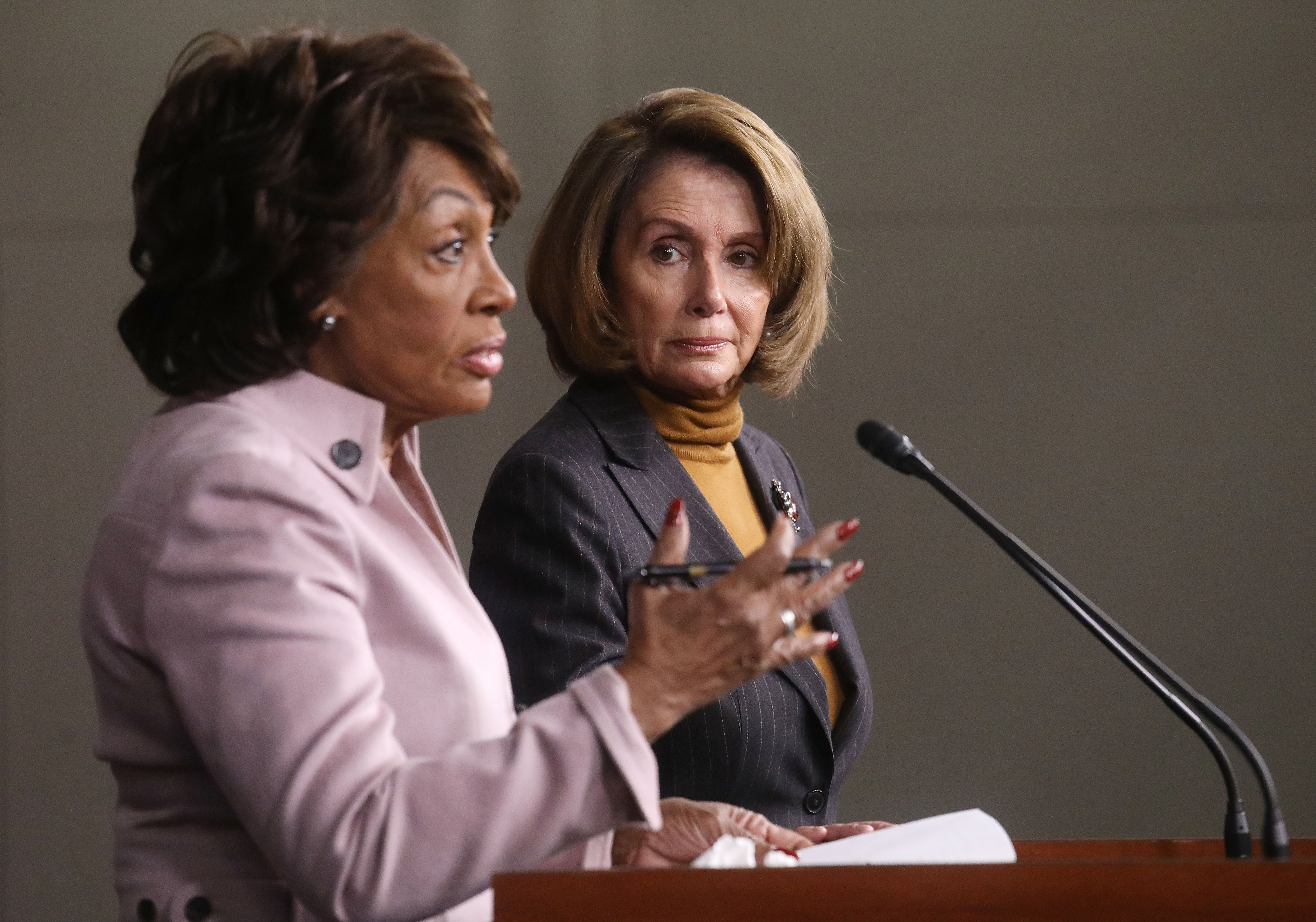 House Minority Leader Nancy Pelosi (D-CA), C, looks on as U.S. Rep. Maxine Waters (D-CA) speaks at a news conference criticizing President Donald Trump's Wall Street policies on Capitol Hill on February 6, 2017 in Washington, D.C. Mario Tama—Getty Images
