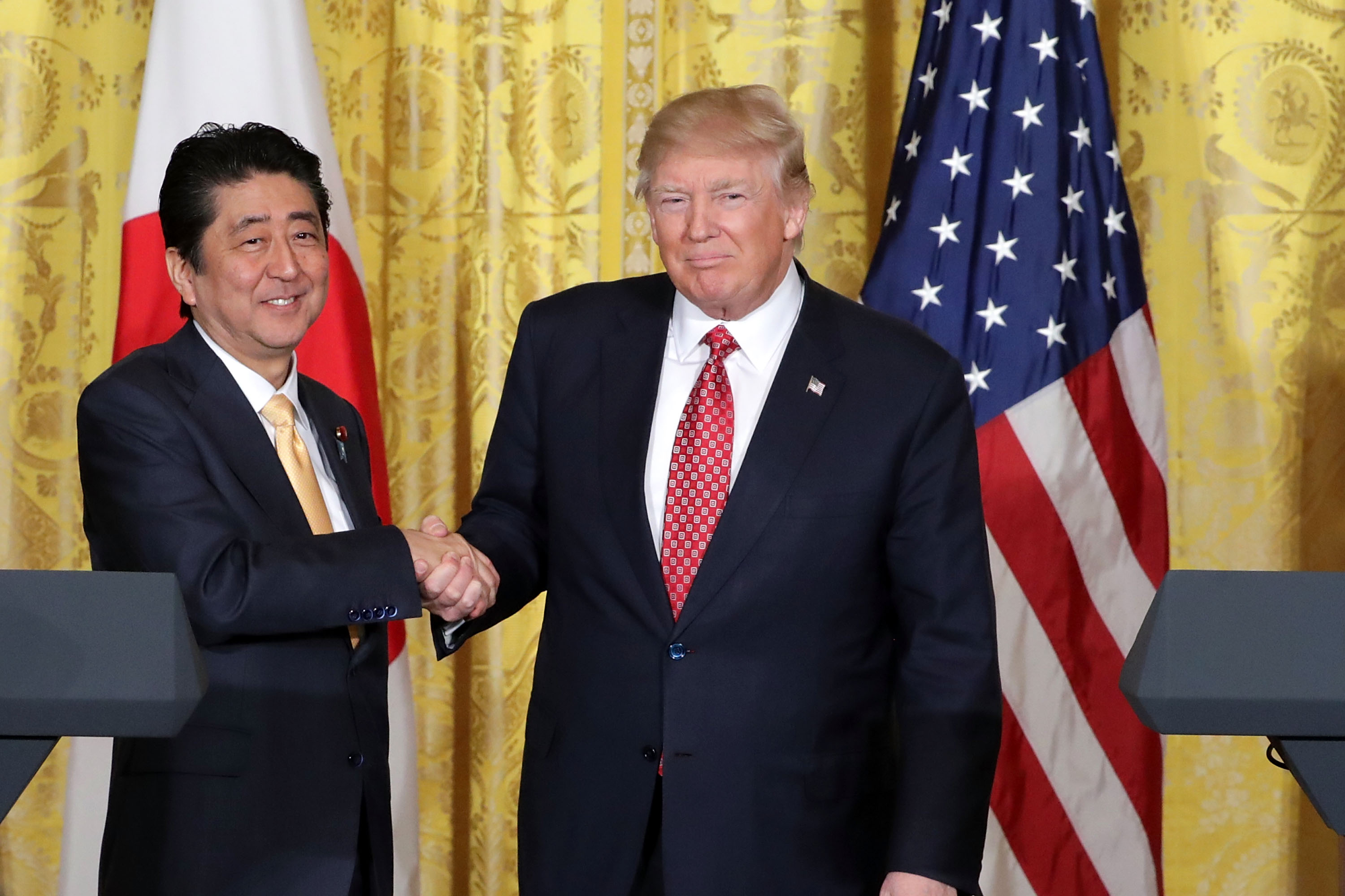 U.S. President Donald Trump and Japanese Prime Minister Shinzo Abe shake hands at the conclusion of a joint news conference in the East Room at the White House February 10, 2017 in Washington, DC.