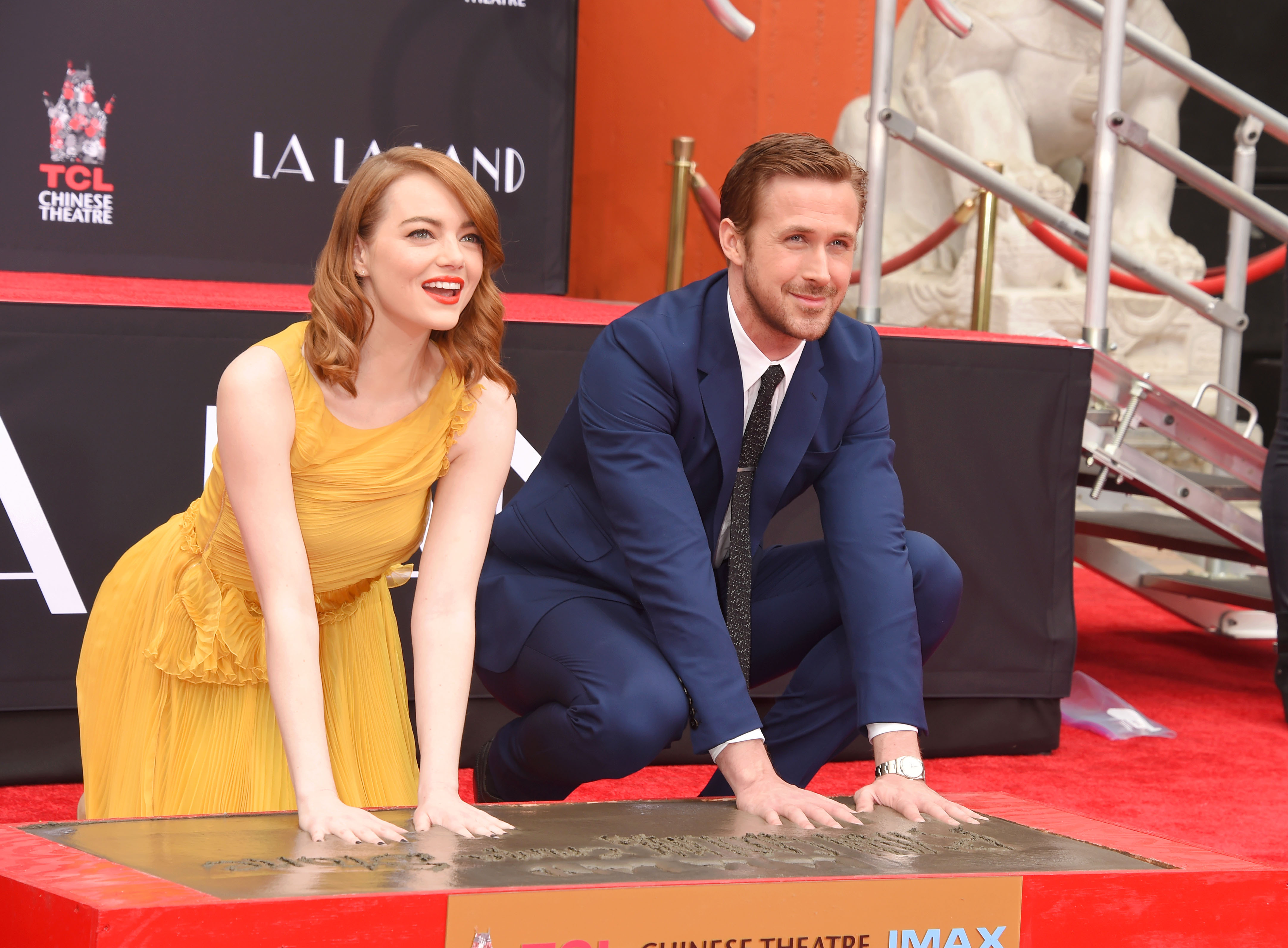 HOLLYWOOD, CA - DECEMBER 07: Actress Emma Stone (L) and actor Ryan Gosling attend the Hand And Footprint Ceremony for Ryan Gosling and Emma Stone at the TCL Chinese Theatre IMAX on December 7, 2016 in Hollywood, California. (Photo by Jeffrey Mayer/WireImage)