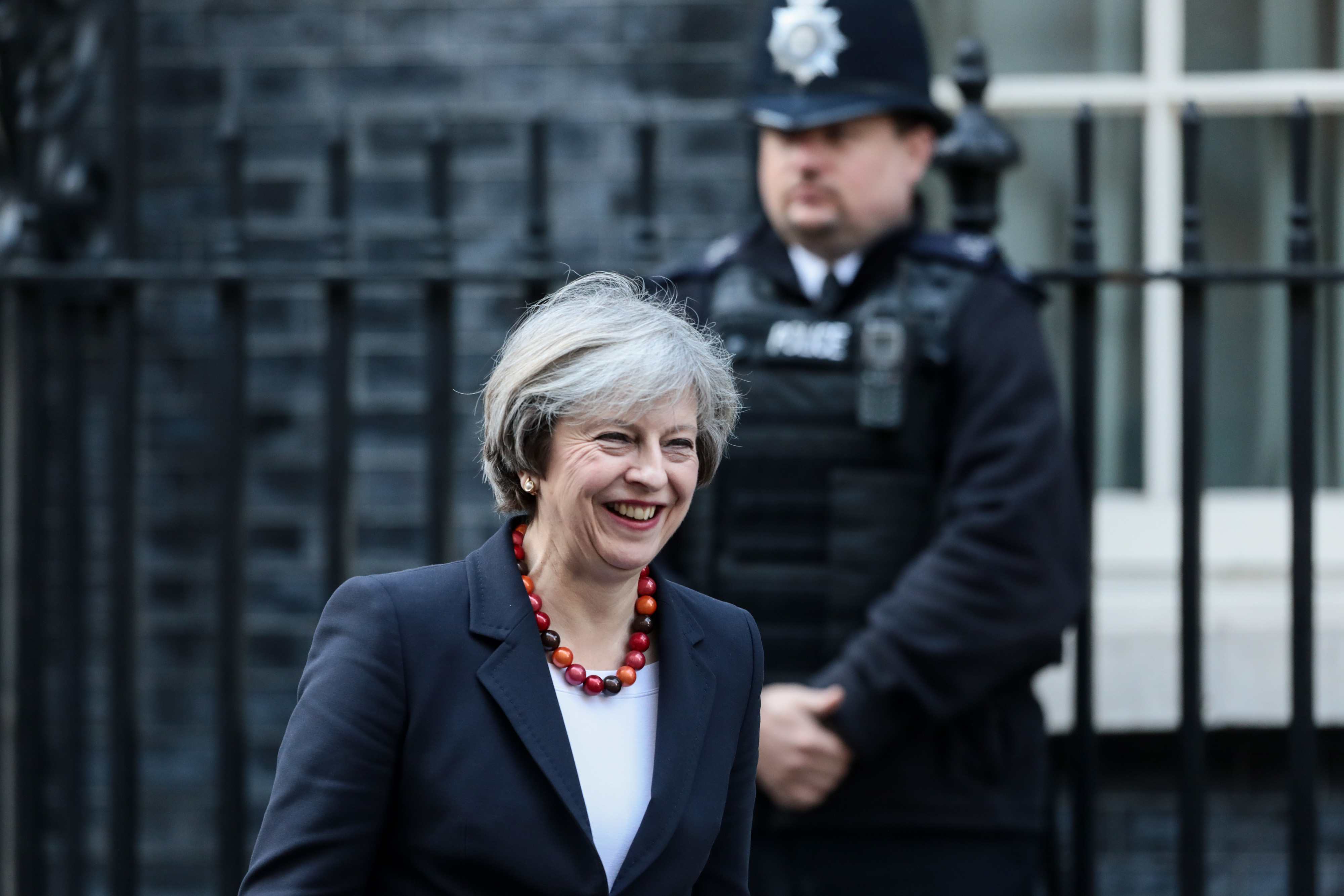 Theresa May, U.K. prime minister, leaves 10 Downing Street to greet France's Prime Minister Bernard Cazeneuve (not pictured) , on Friday, Feb. 17, 2017 in London, U.K.