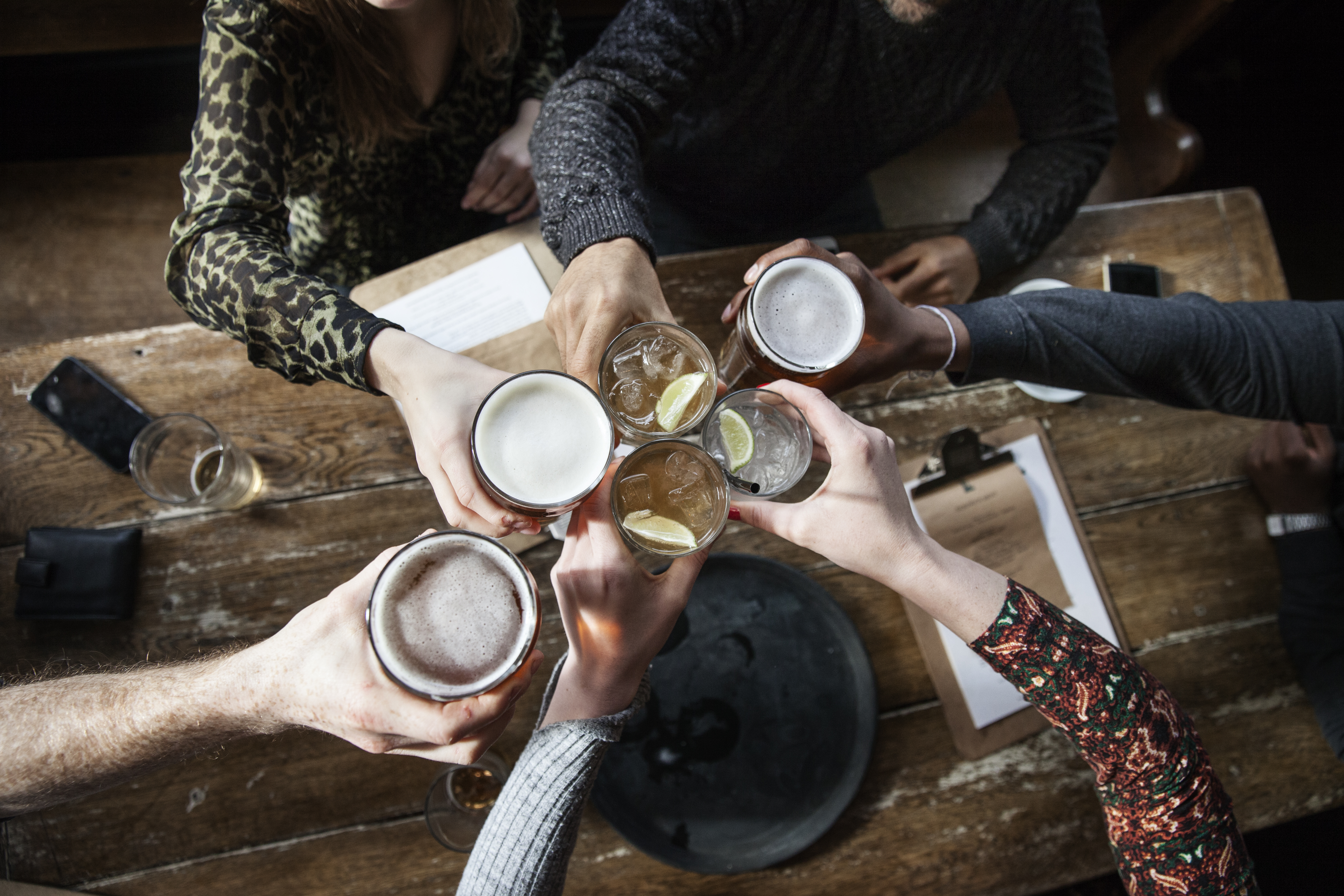 Stock photo of friends toasting at a pub