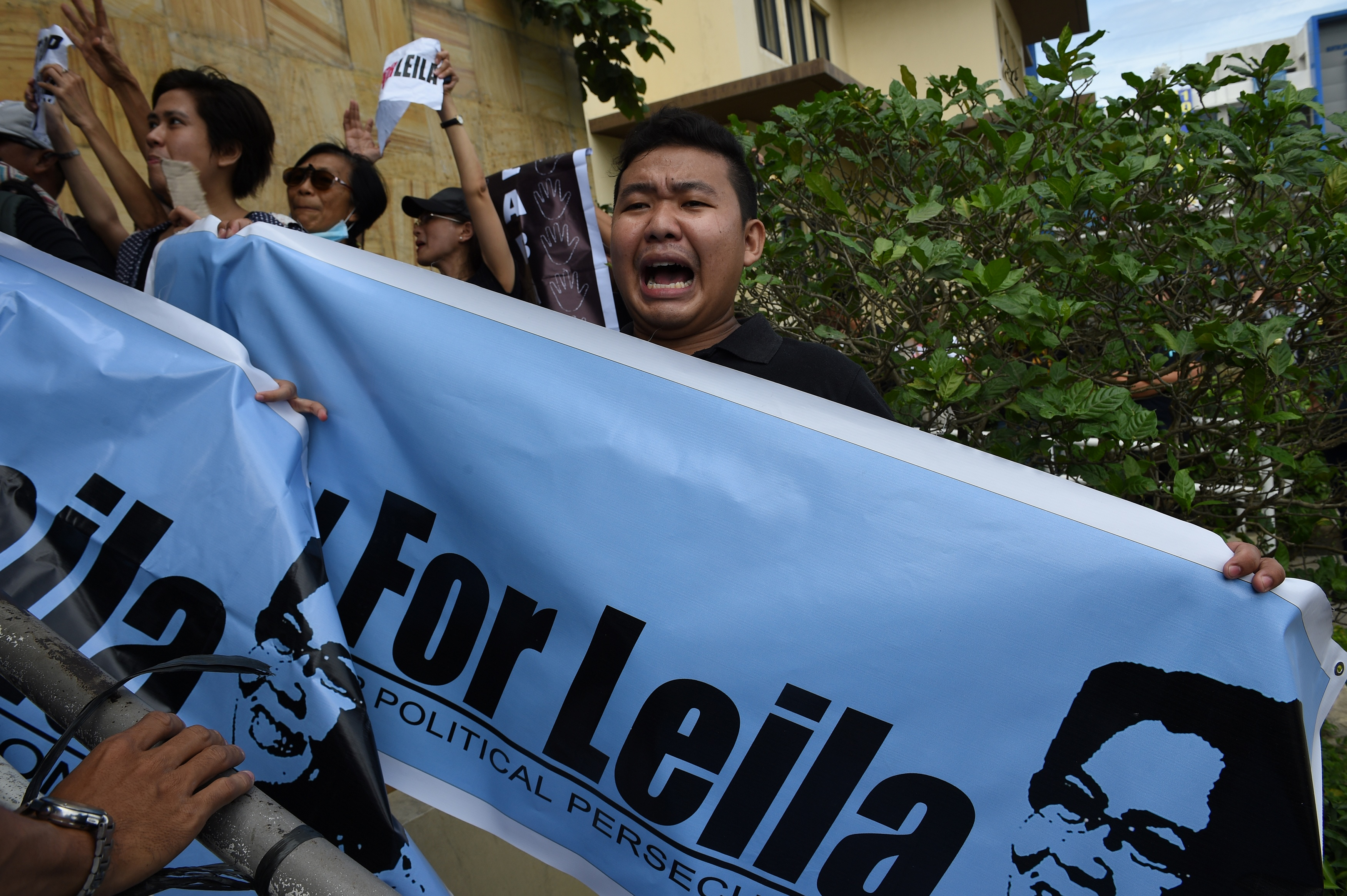 A supporter of Senator Leila De Lima shouts slogans as they hold a rally outside the court building in Muntinlupa City, suburban Manila on Feb. 24, 2017.
