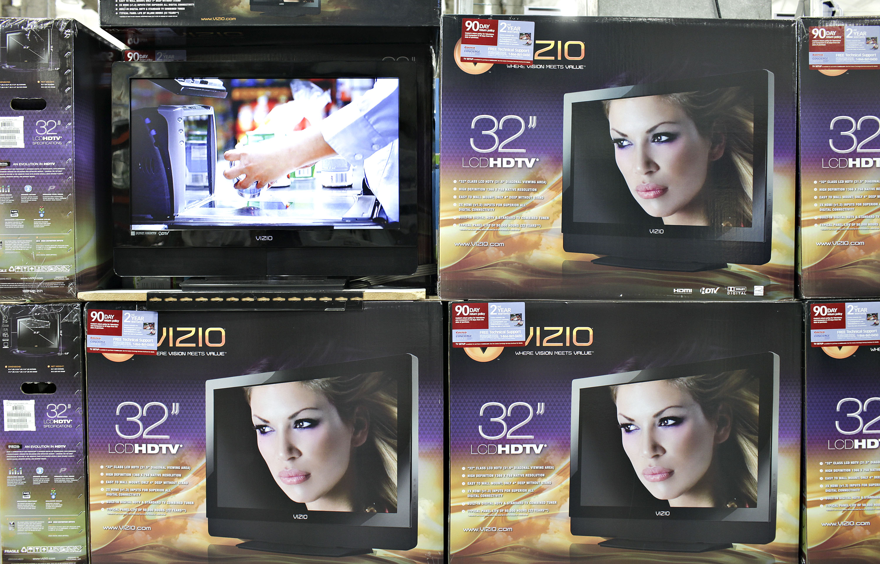 ViZio flat screen televisions sit on display inside a Costco store in Queens, New York, U.S., on Thursday, May 28, 2009.