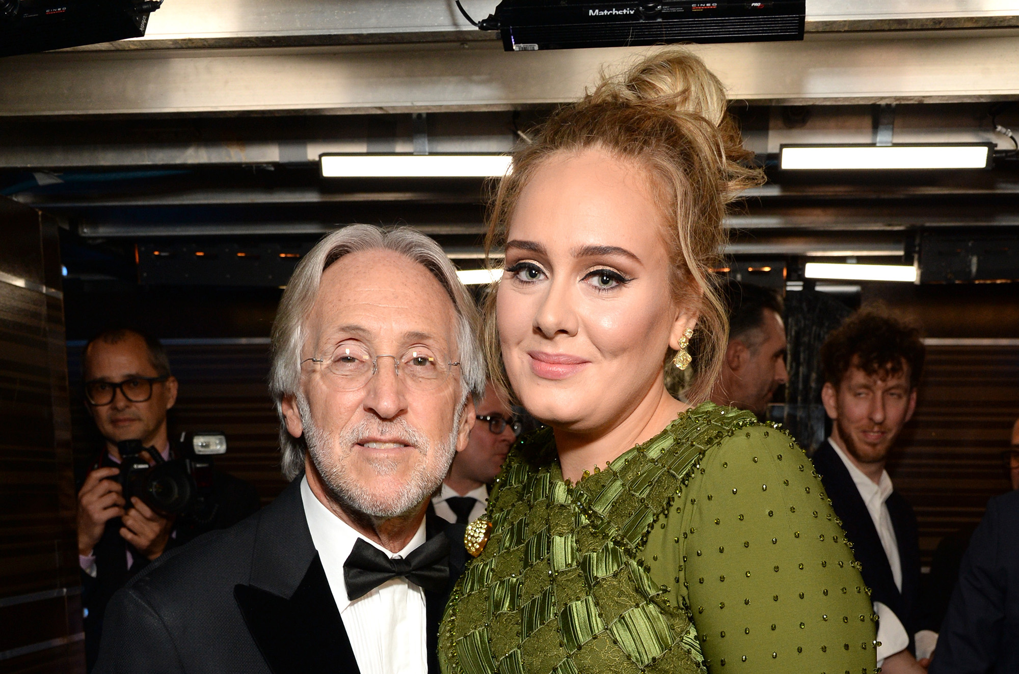 President/CEO of The Recording Academy and GRAMMY Foundation President/CEO Neil Portnow (L) and Adele backstage during during the The 59th GRAMMY Awards.