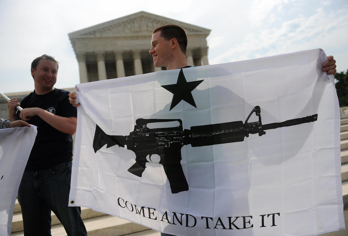 Gun rights activists celebrate the news from the U.S. Supreme Court on June 26, 2008 that ended a ban on owning handguns in Washington, D.C.